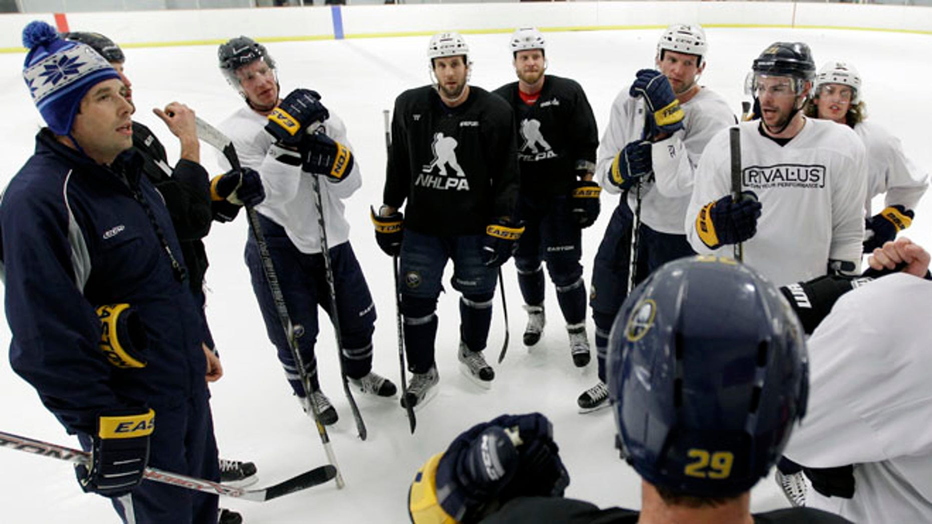 Former Buffalo Sabres player Andrew Peters, left, attends a Sabres workout in 2013.