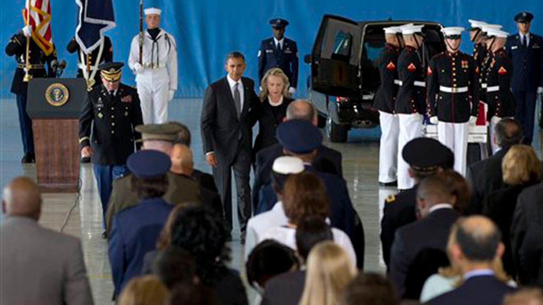FILE: Sept. 14, 2012: President Obama and Secretary of State Hillary Clinton walk back to their seats after speaking during the Transfer of Remains Ceremony at Andrews Air Force Base, Md.