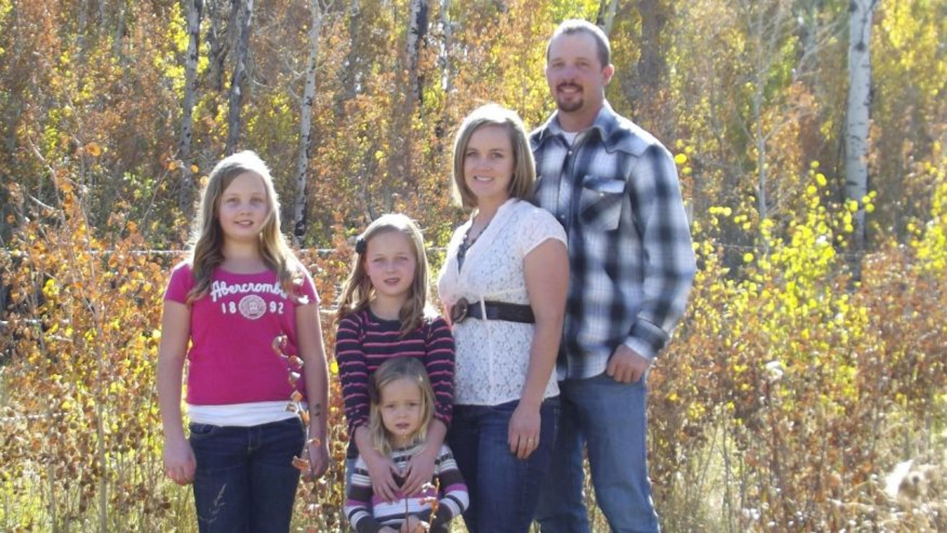 Andy Johnson, of Fort Bridger, Wy., is pictured in an undated photo with his wife and daughters.