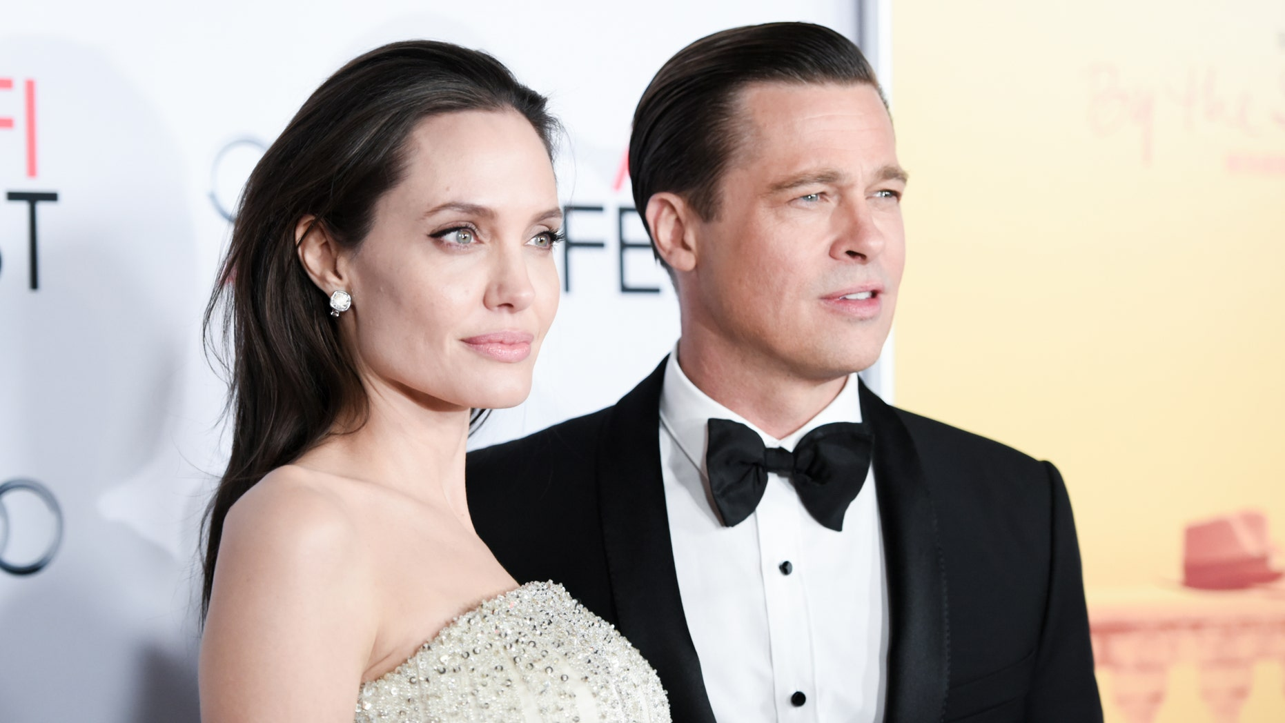 """November 5, 2015. Angelina Jolie, left, and Brad Pitt arrive at the 2015 AFI Fest opening night premiere of """"By The Sea."""""""