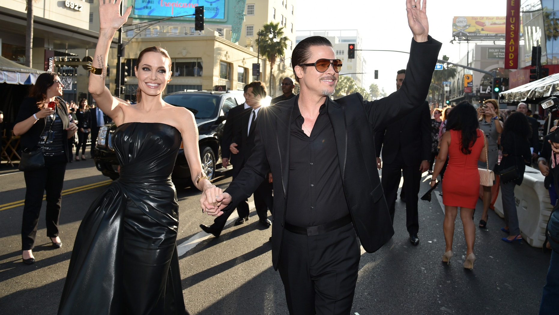 """May 28, 2014. Angelina Jolie, left, and Brad Pitt arrive at the world premiere of """"Maleficent"""" at the El Capitan Theatre in Los Angeles."""