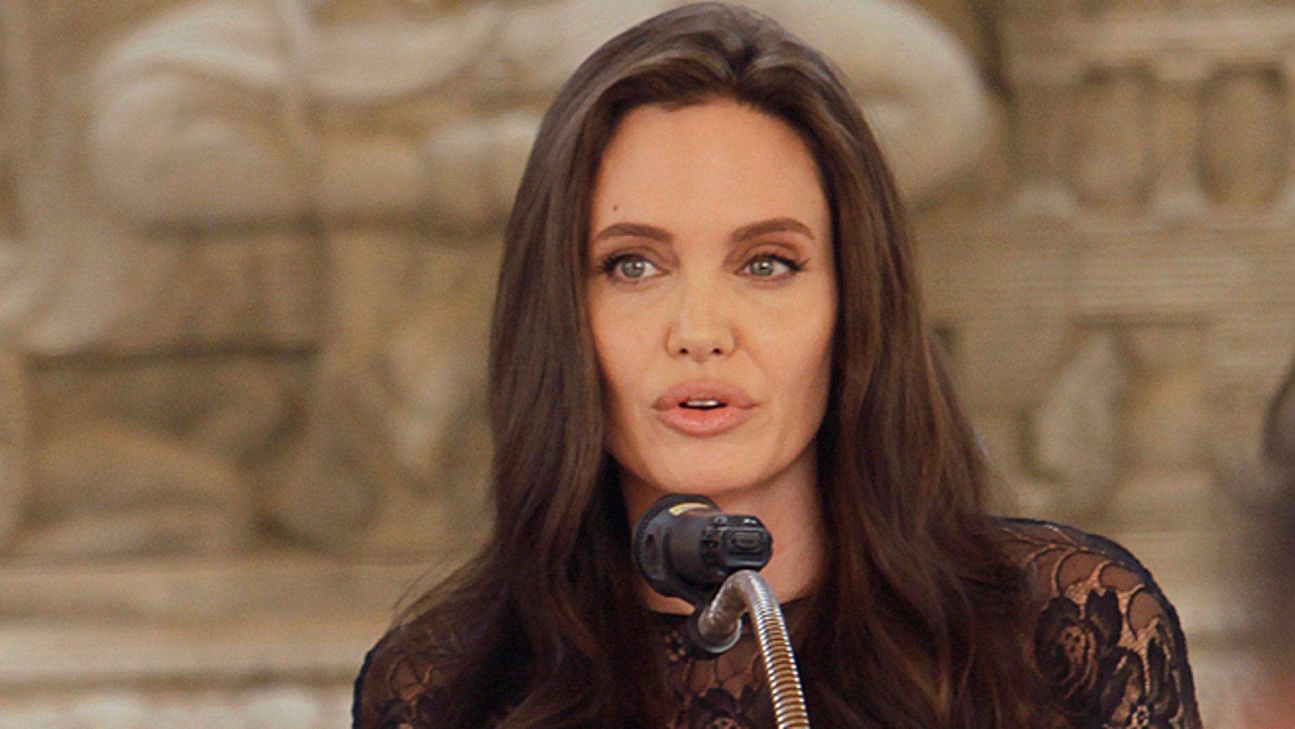 "Angelina Jolie at a press conference in Cambodia for her latest film ""First They Killed My Father."""
