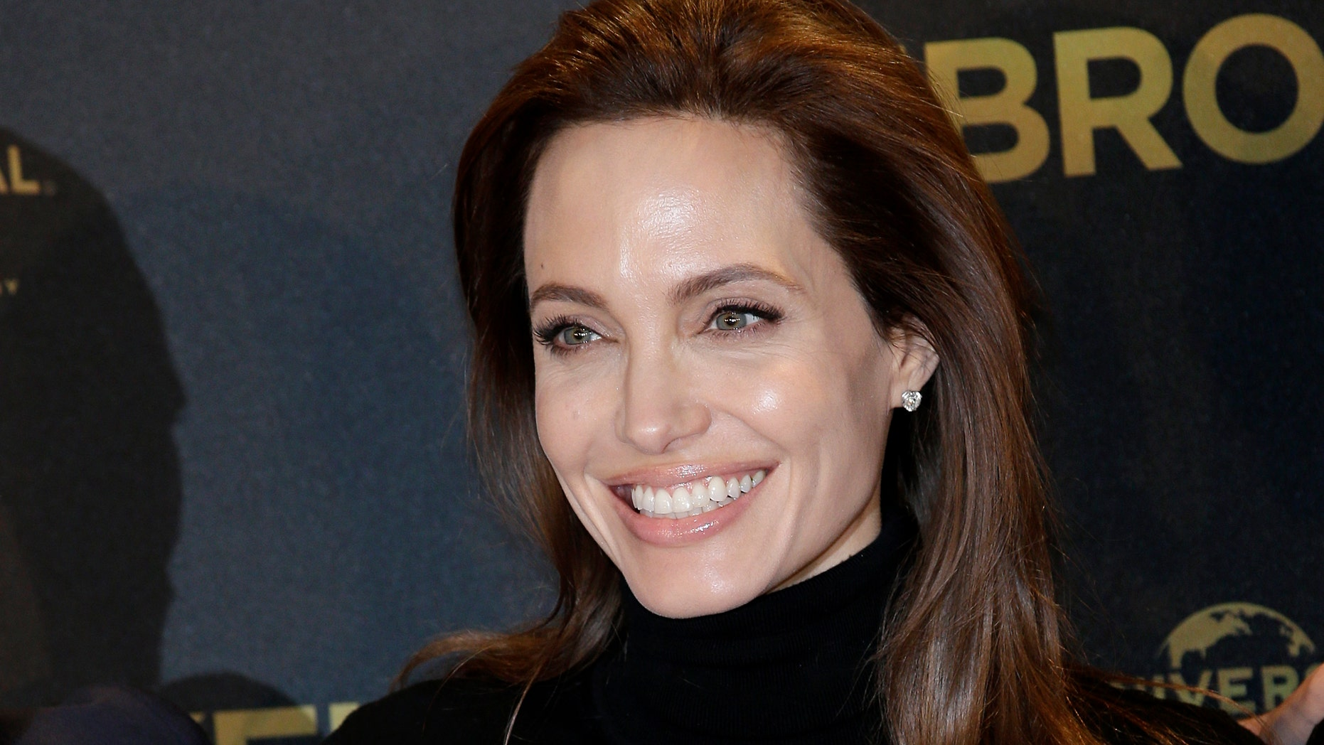 """Nov. 27, 2014. Director Angelina Jolie poses for photographers during a photo call for her film """"Unbroken"""" in Berlin, Germany."""