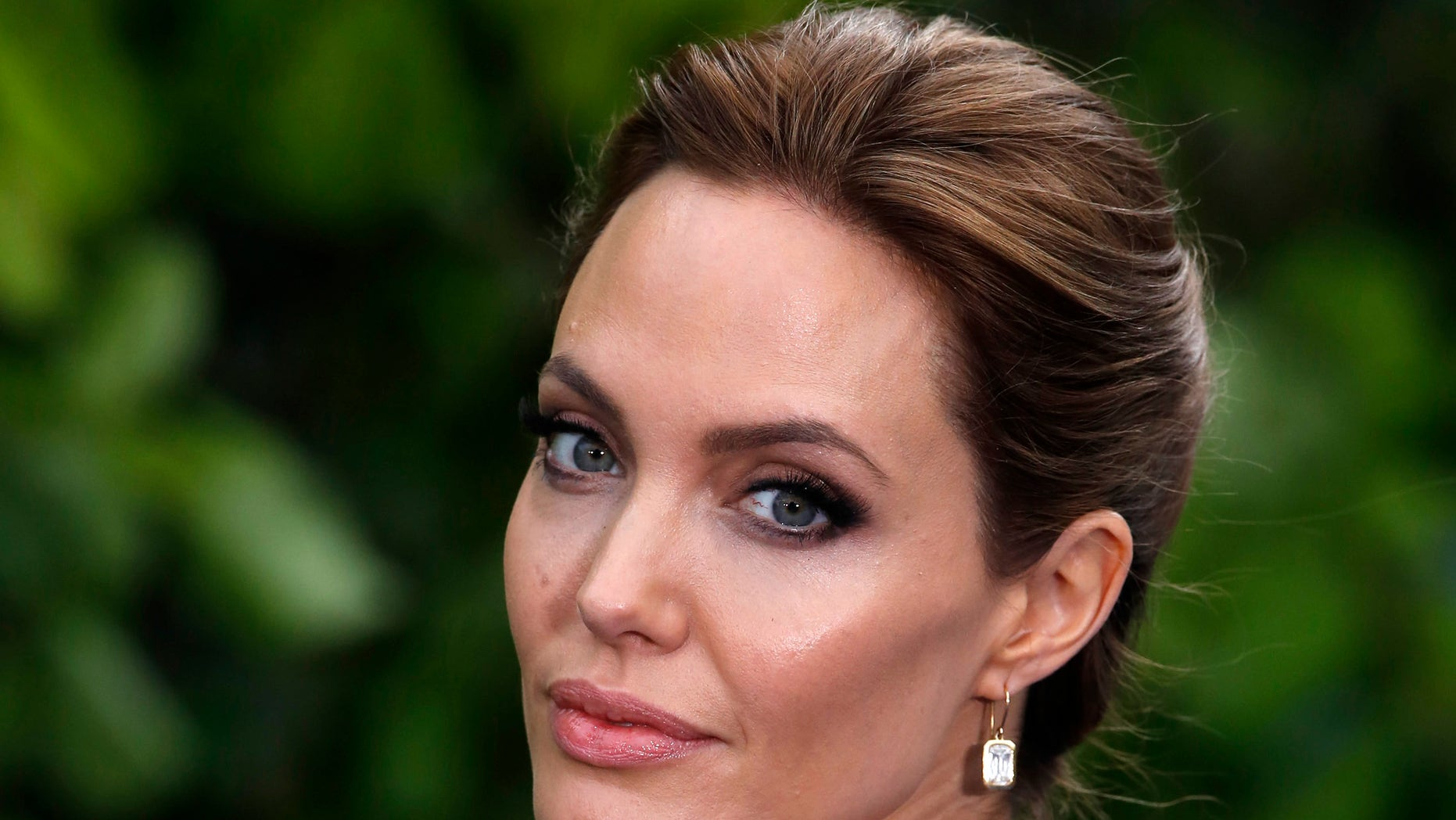 May 8, 2014. Actress Angelina Jolie arrives for a special Maleficent Costume Display at Kensington Palace in London.