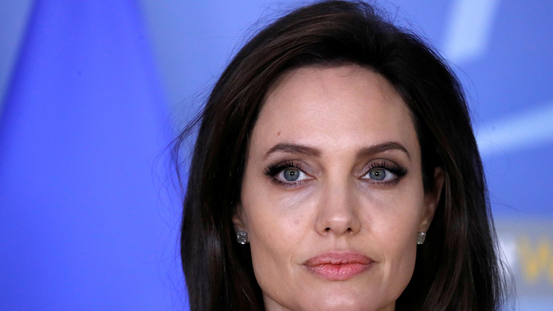 UNHCR Special Envoy actor Angelina Jolie takes part in a news conference at the NATO headquarters in Brussels, Belgium, January 31, 2018. REUTERS/Yves Herman - RC1FB8FE35C0