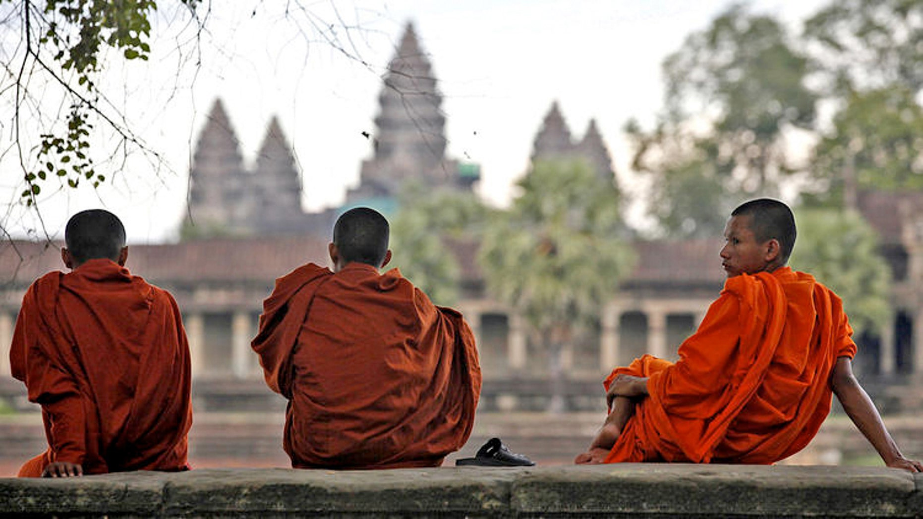 Buddhist monks on the grounds of Angkor Wat.