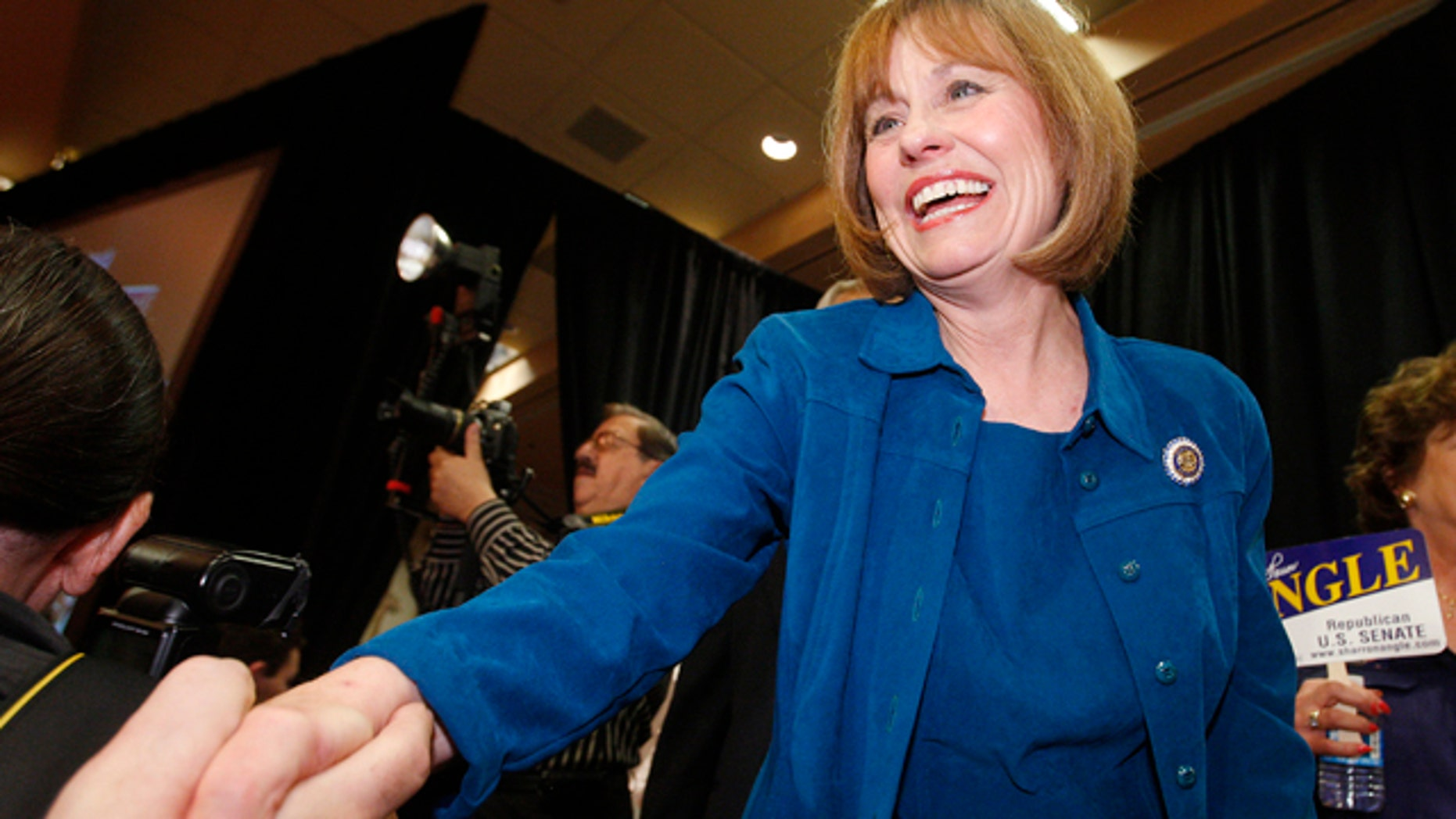 June 8: Nevada Republican Senate candidate Sharron Angle shakes hands of supporters in Las Vegas.