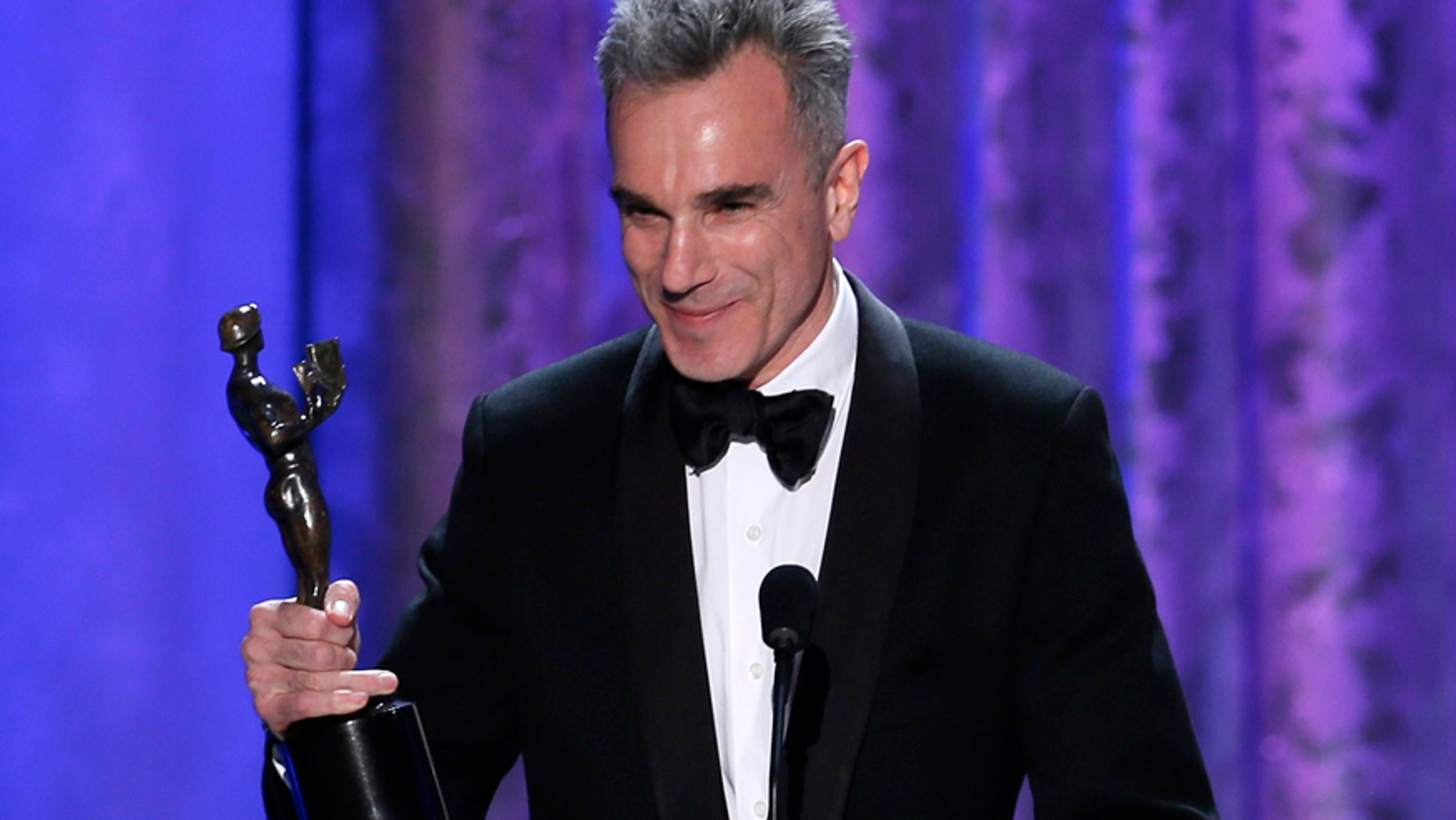 """Daniel Day-Lewis accepts the award for outstanding male actor in a leading role for """"Lincoln"""" at the 19th annual Screen Actors Guild Awards in Los Angeles, California January 27, 2013."""