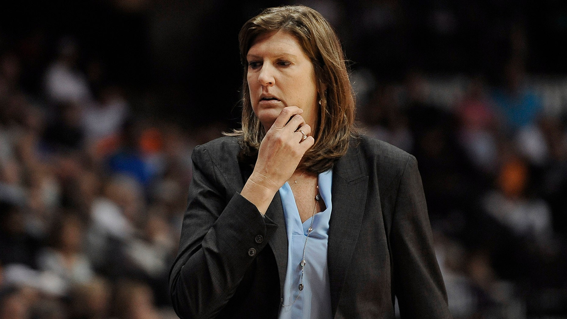 In this July 31, 2015, file photo. Connecticut Sun coach Anne Donovan watches her players in a WNBA basketball game against the Seattle Storm in Uncasville, Conn.