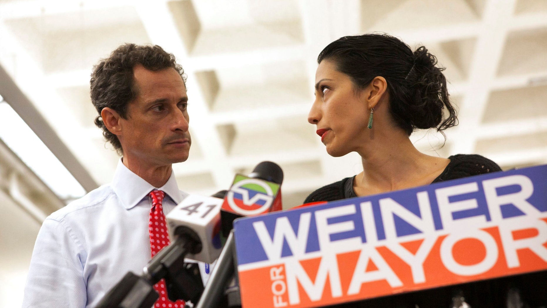 FILE - New York mayoral candidate Anthony Weiner and his wife Huma Abedin attend a news conference in New York, July 23, 2013.