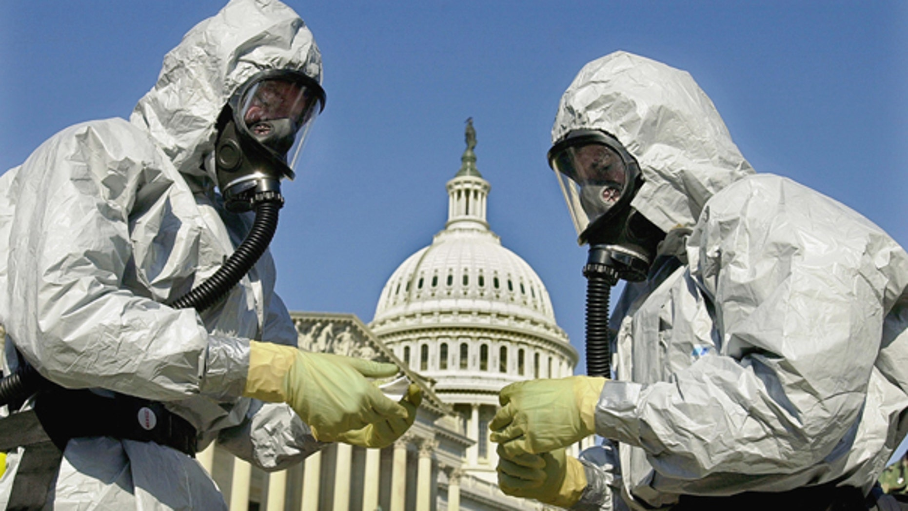 FILE: In this Oct. 30, 2001, file photo, members of the U.S. Marine Corps' Chemical-Biological Incident Response Force demonstrate anthrax clean-up techniques during a news conference in on Capitol Hill in Washington.  (AP Photo)