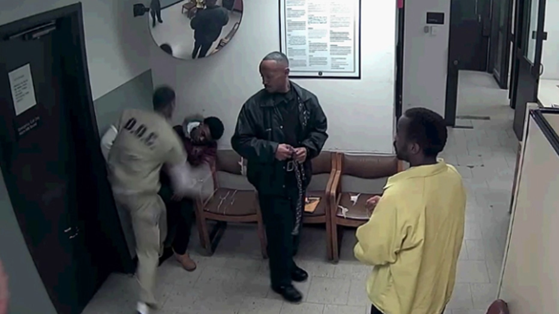Screen grab from video showing Antwan Jones, 19, being attacked in a Chicago courthouse lockup Wednesday.