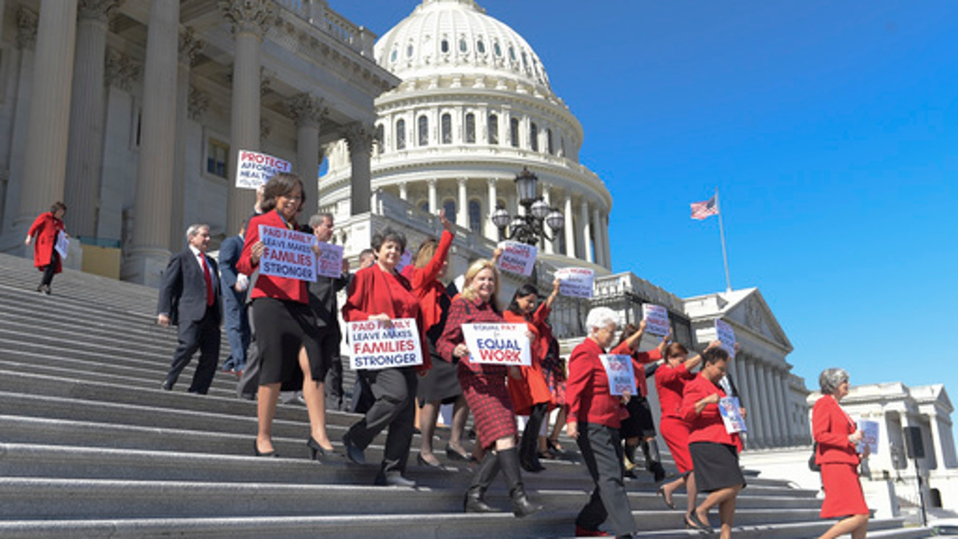 Democratic House members walk down the steps of Capitol Hill in Washington, Wednesday, March 8, 2017, for an event to honor International Women's Day. (AP Photo/Susan Walsh)