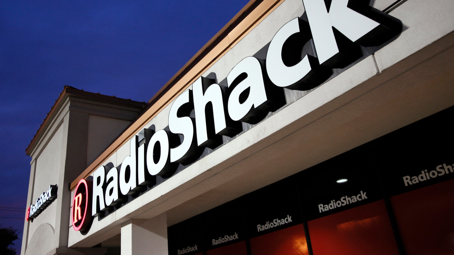 FILE - This Tuesday, Feb. 3, 2015 file photo shows a RadioShack store in Dallas. Troubled electronics retailer RadioShack has filed for bankruptcy for the second time in just over two years.