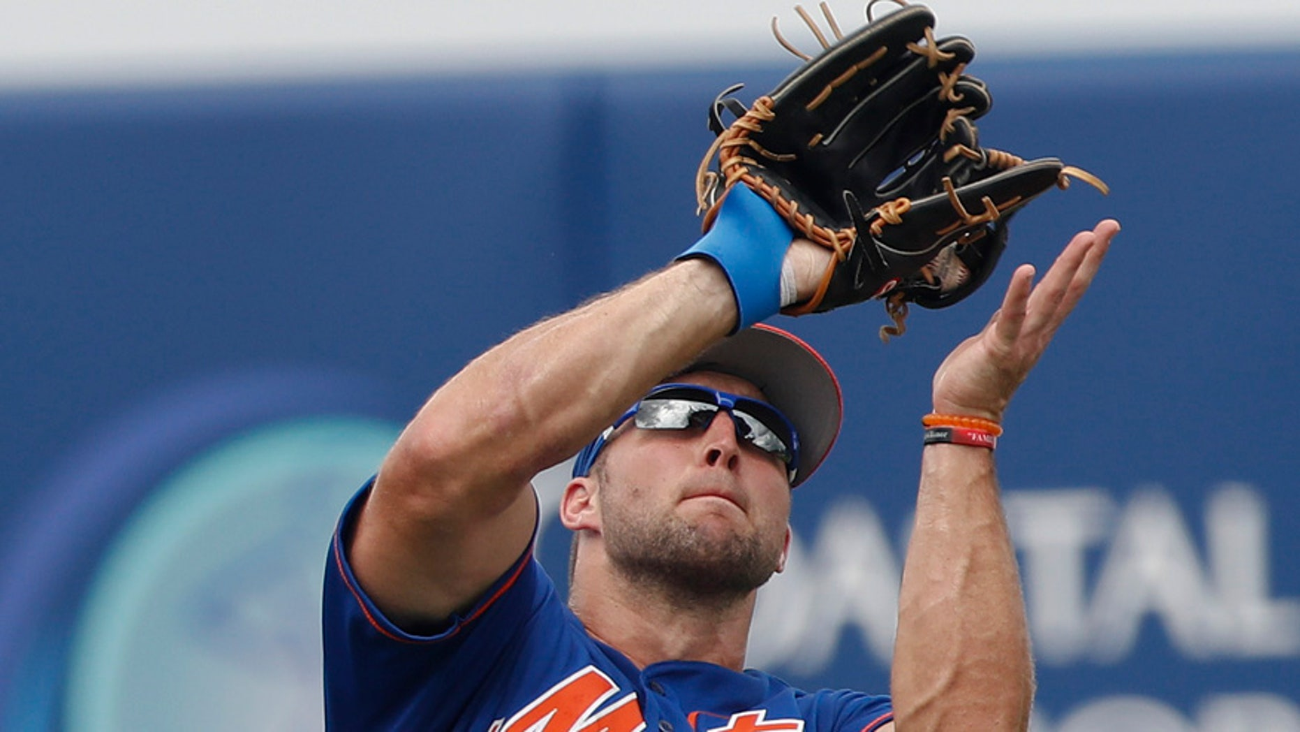 New York Mets left fielder Tim Tebow catches a fly ball in a spring training baseball game against the Miami Marlins Monday, March 13, 2017, in Port St. Lucie, Fla. (AP Photo/John Bazemore)