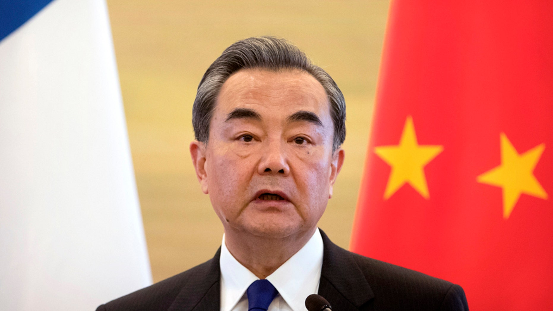 Chinese Foreign Minister Wang Yi speaks during a joint press conference with his French counterpart Jean-Marc Ayrault at the Ministry of Foreign Affairs in Beijing, Friday, April 14, 2017. (AP Photo/Mark Schiefelbein)