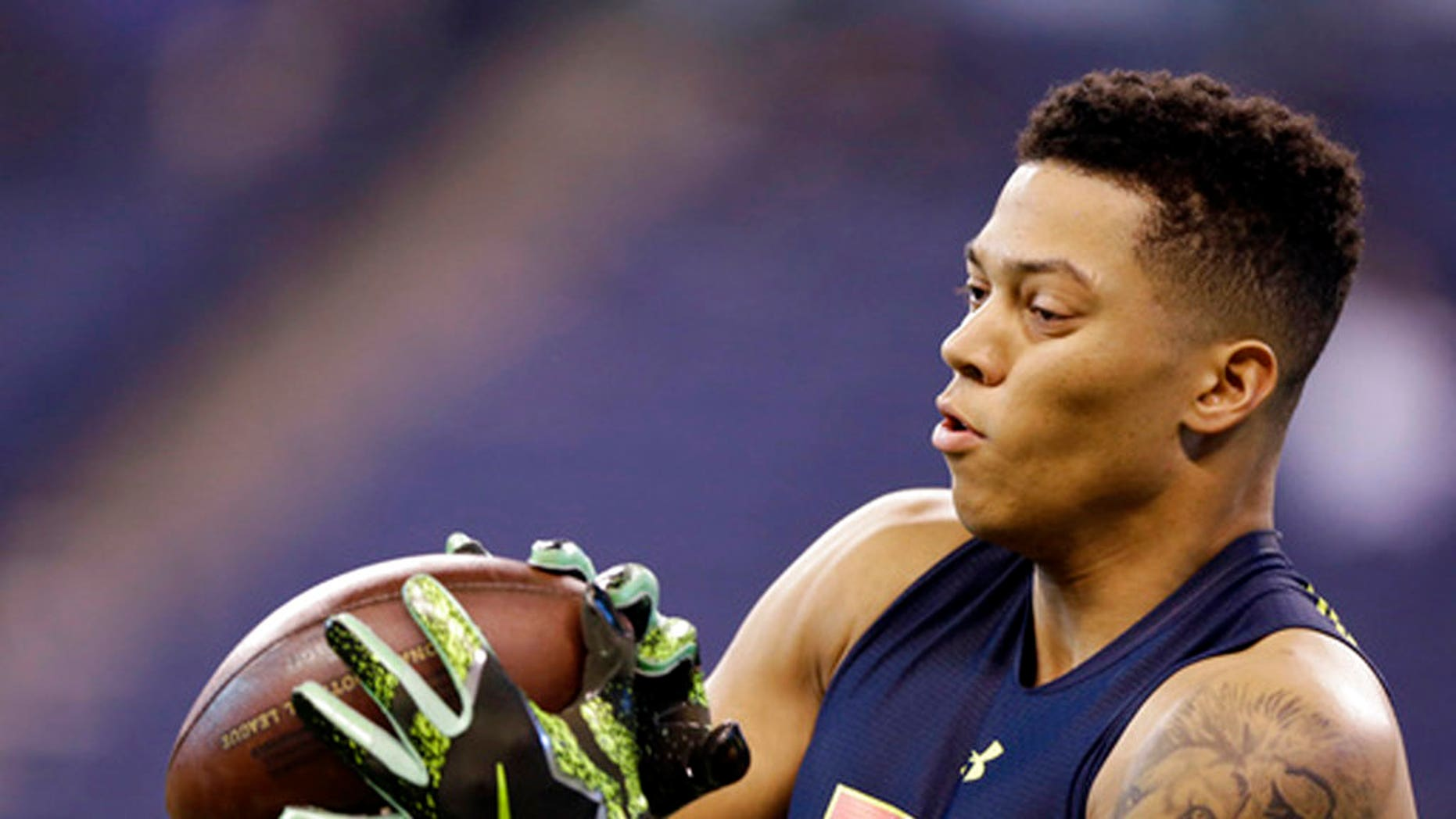 Air Force wide receiver Jalen Robinette makes a catch as he runs a drill at the NFL football scouting combine in Indianapolis.