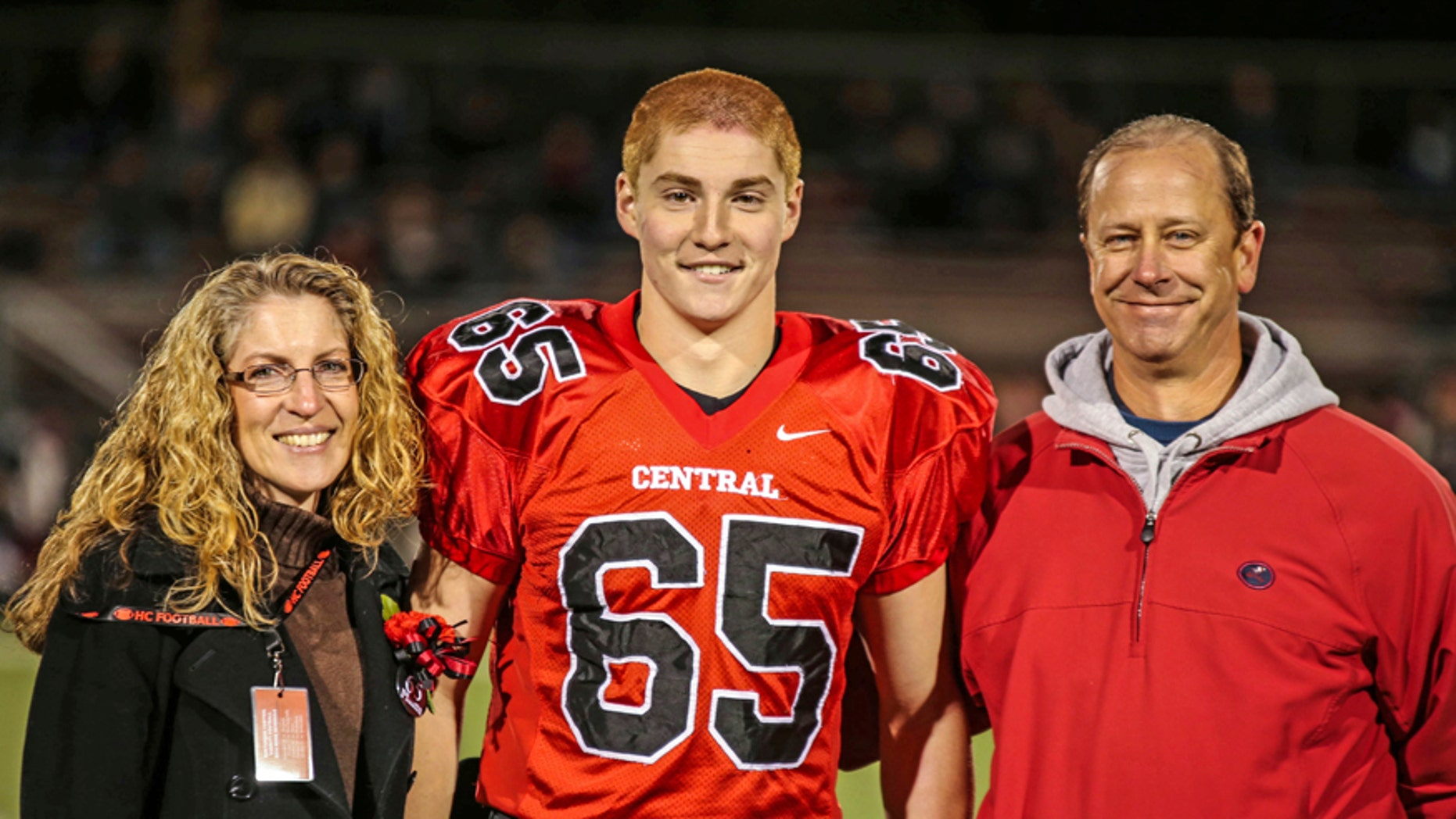 Timothy Piazza, center, with his parents Evelyn Piazza, left, and James Piazza, right, at Hunterdon Central Regional High School in 2014.
