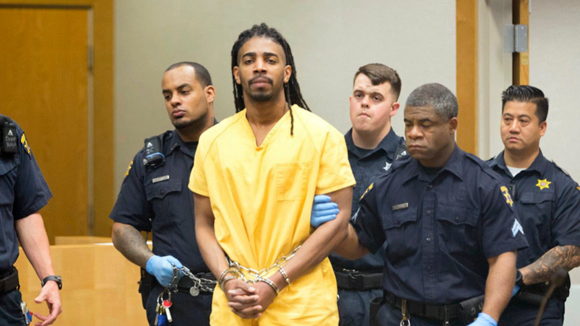 Wesley Correa-Carmenaty is escorted into court for his initial appearance, Wednesday May 3, 2017, in Omaha, Neb. Correa-Carmenaty, a convicted felon, is accused of shooting two western Iowa deputies then escaping in a jail van before being recaptured in Nebraska had his bail set at $10 million. (Kent Sievers/Omaha World-Herald via AP)