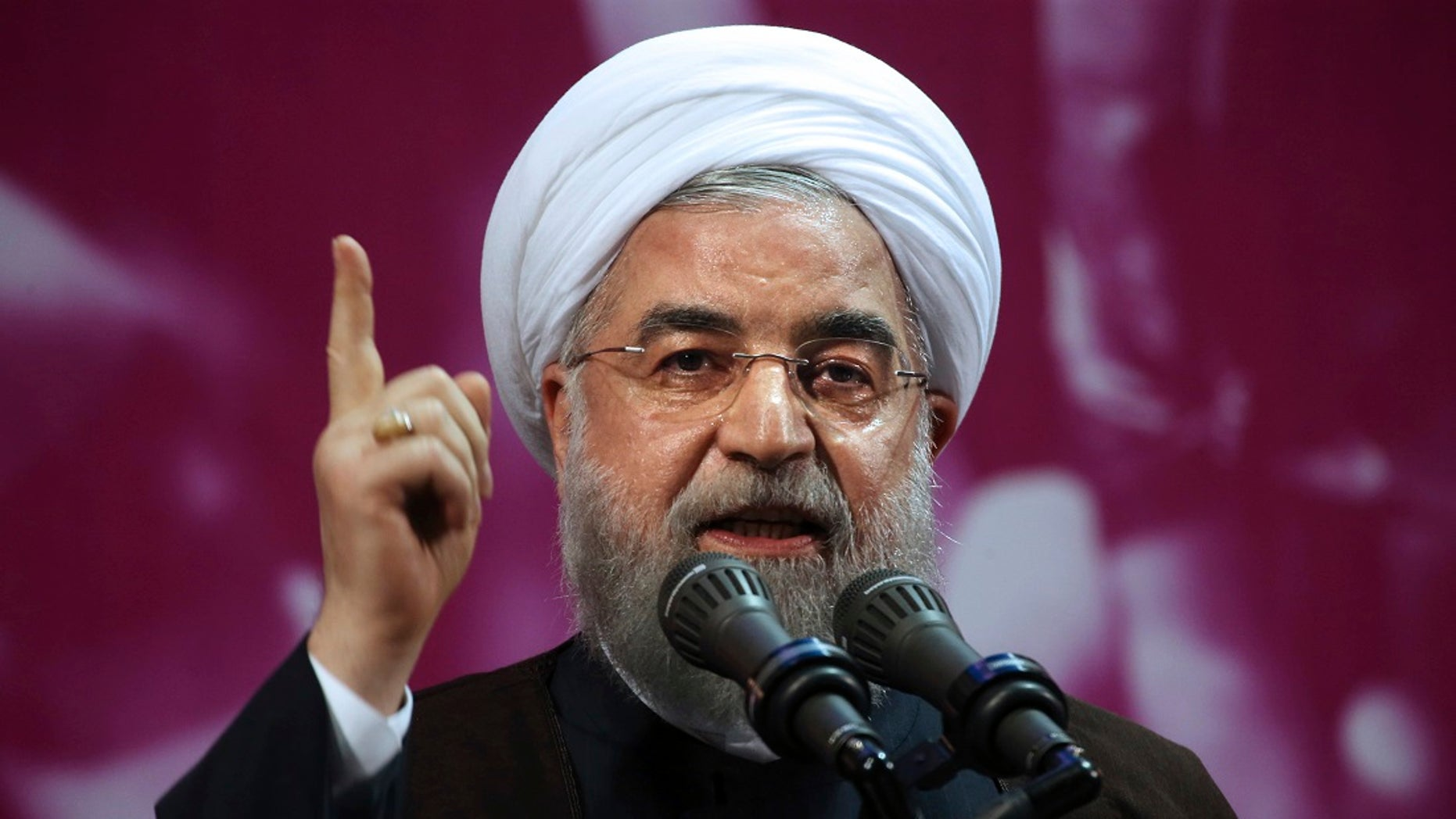 Iranian President Hassan Rouhani speaks in a campaign rally for May 19 presidential election in Tehran, Iran, Tuesday, May 9, 2017. He faces cleric Ebrahim Raisi.