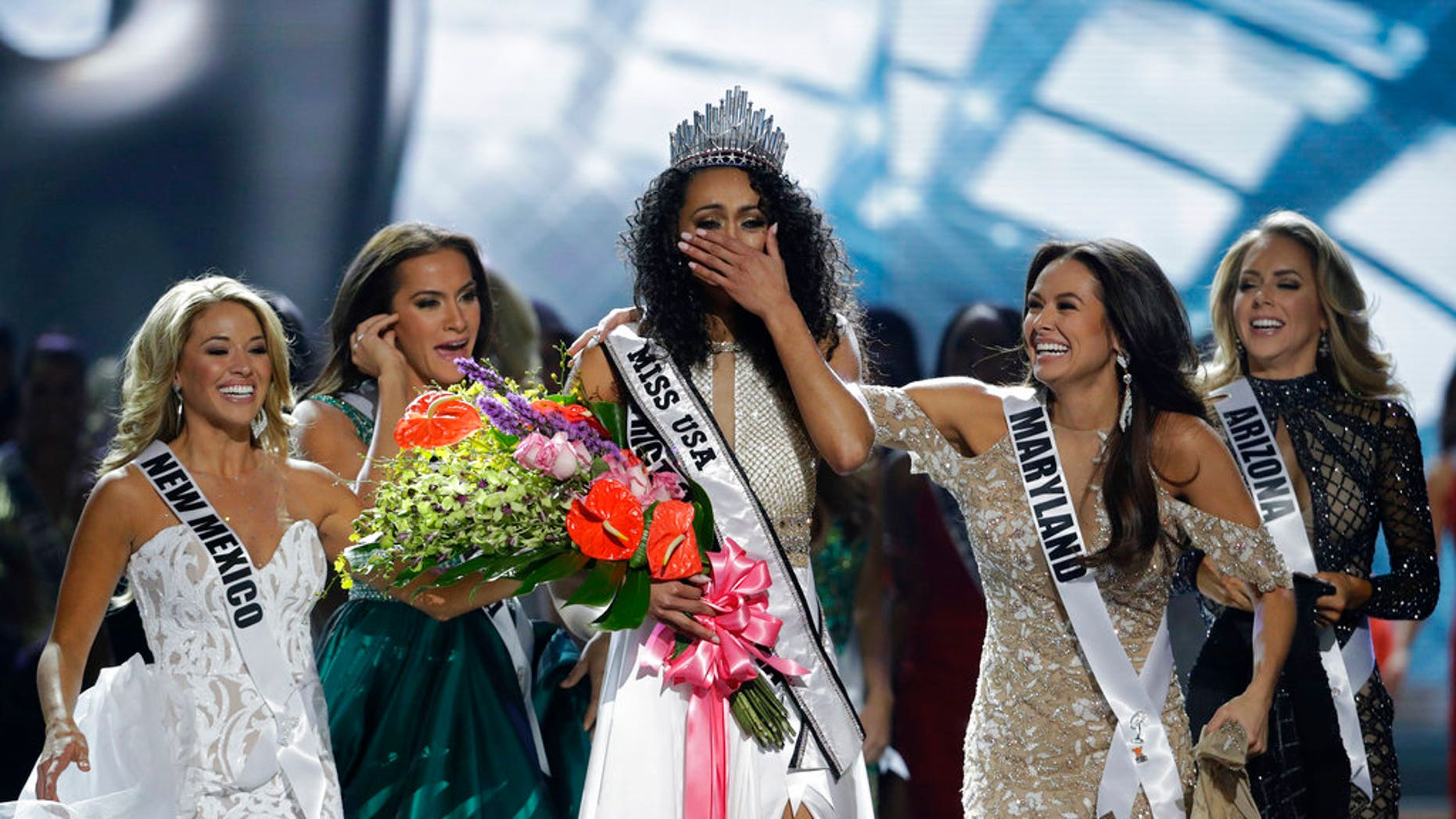 Miss District of Columbia USA Kara McCullough reacts after she was crowned the new Miss USA during the Miss USA contest Sunday, May 14, 2017, in Las Vegas.