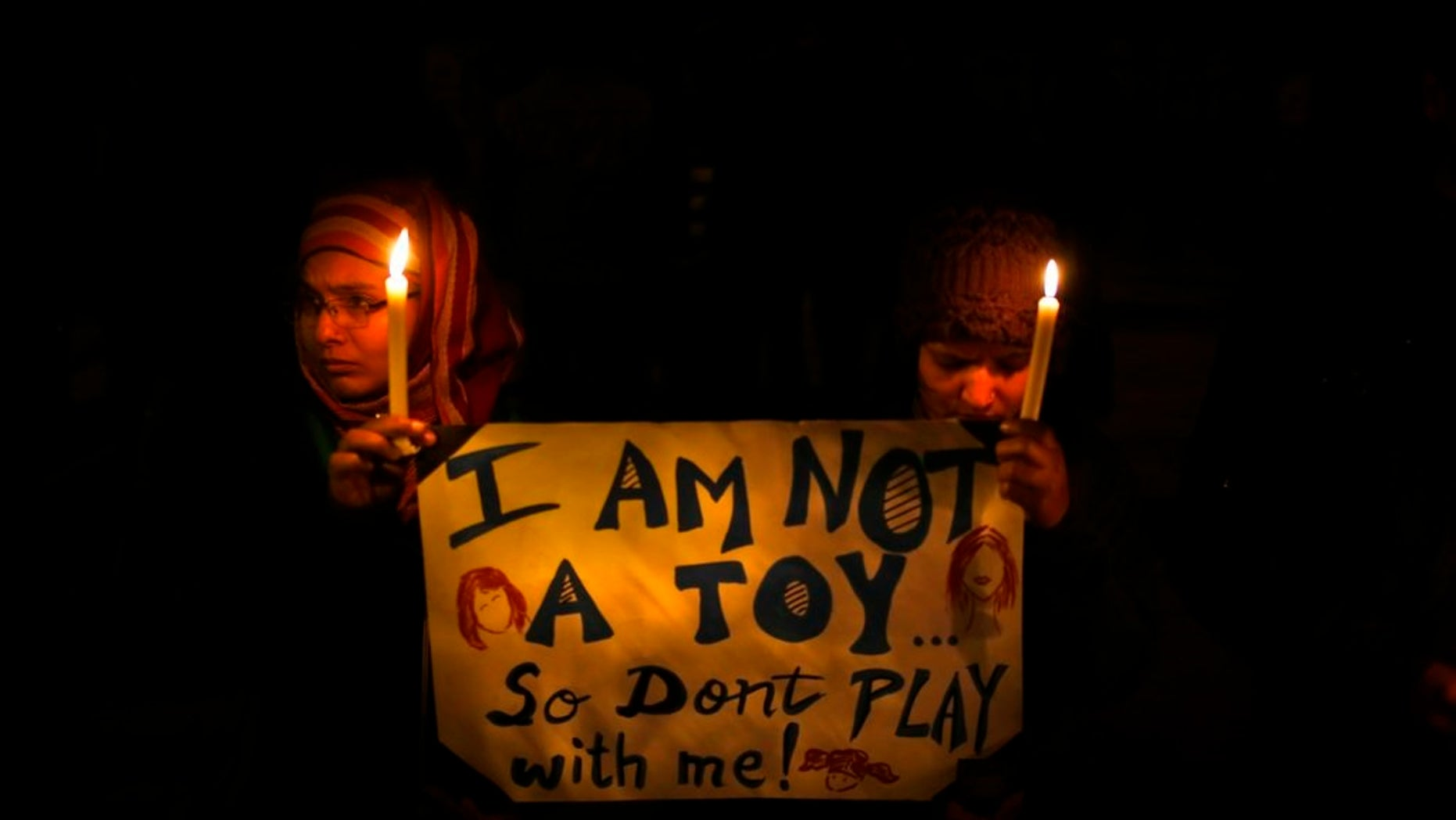 People in India hold a candlelight vigil in New Delhi to mourn the death of a gang rape victim in December 2012.
