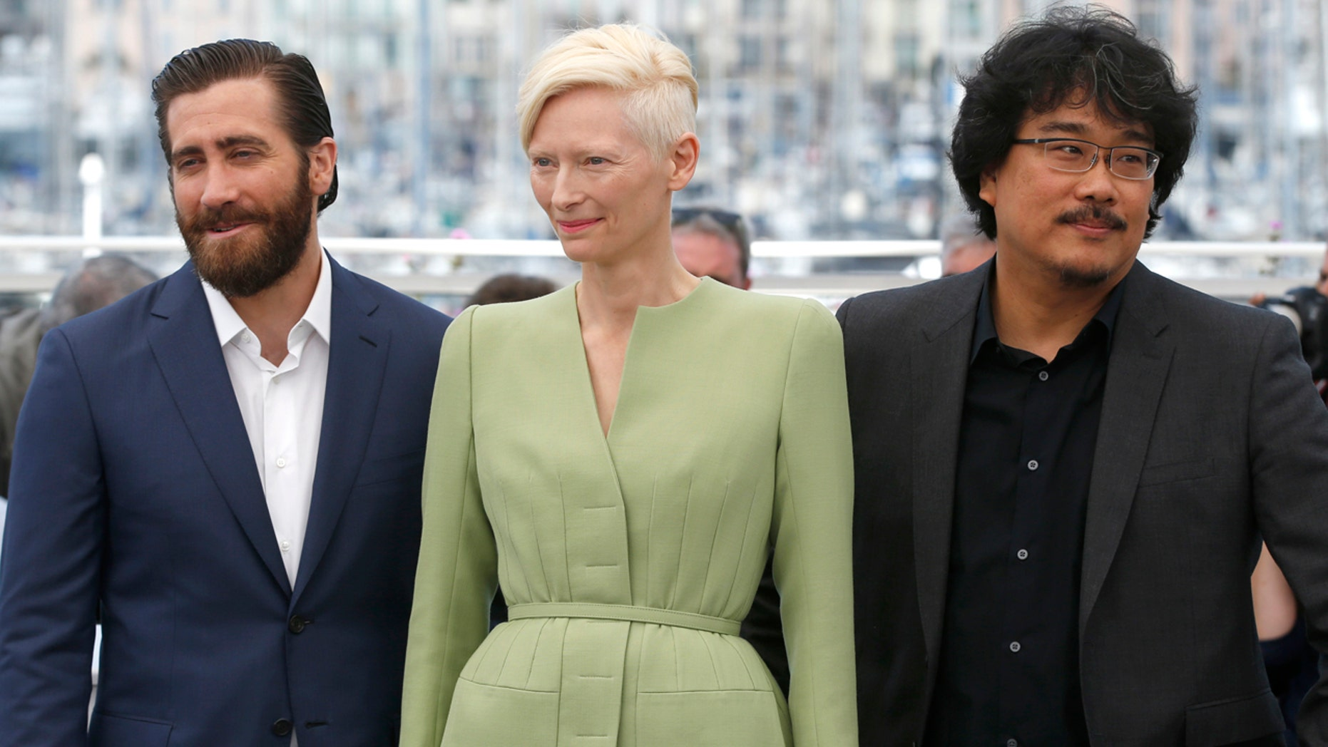 Actors Jake Gyllenhaal, from left, Tilda Swinton and director Bong Joon-Ho pose for photographers during the photo call for the film Okja at the 70th international film festival, Cannes, southern France, Friday, May 19, 2017. (AP Photo/Alastair Grant)