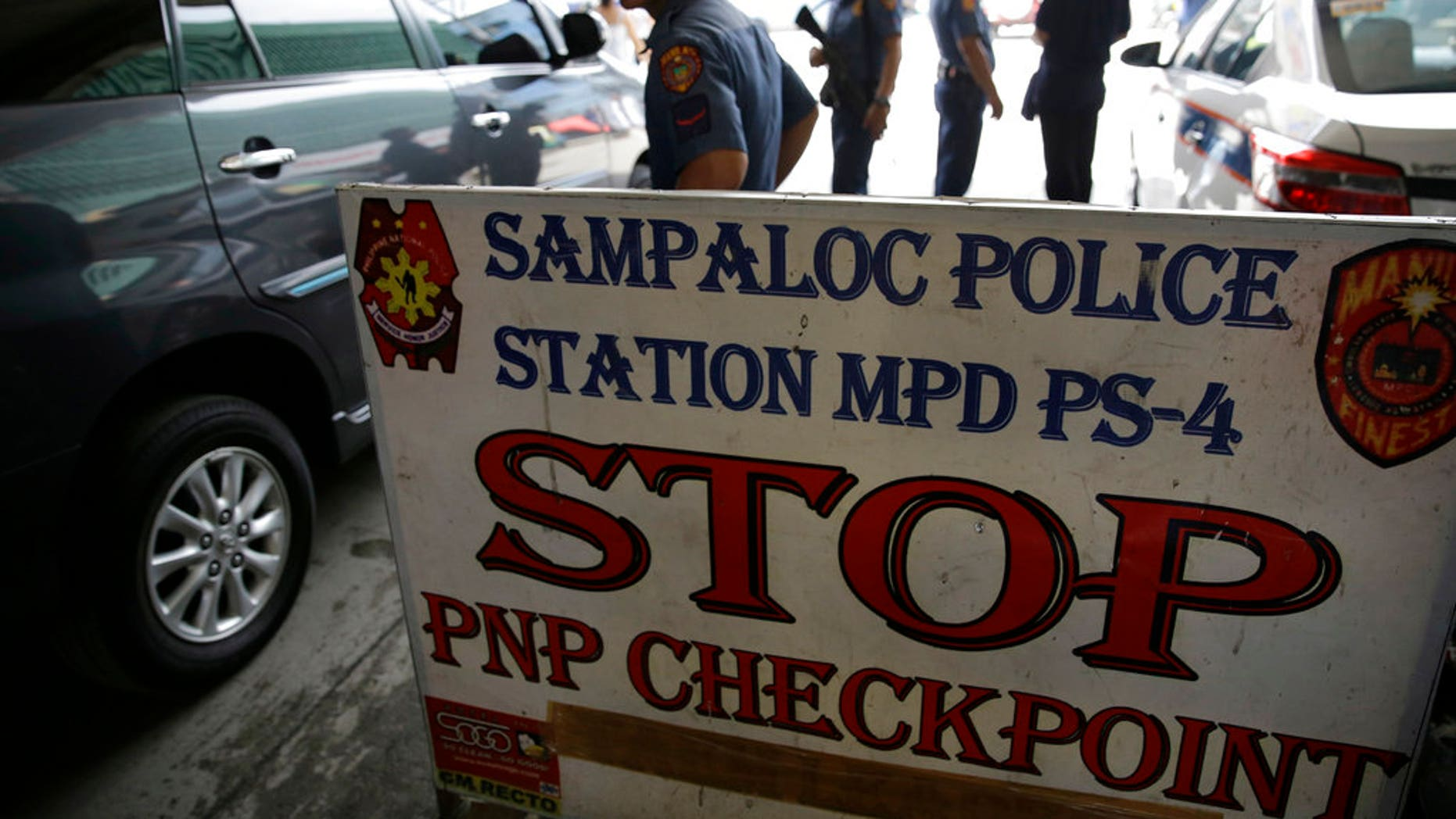 Policemen watches vehicles at a checkpoint in Manila, Philippines, Wednesday, May 24, 2017 as the Philippine National Police is placed under full alert status following the declaration of martial law in Mindanao southern Philippines. (Associated Press)