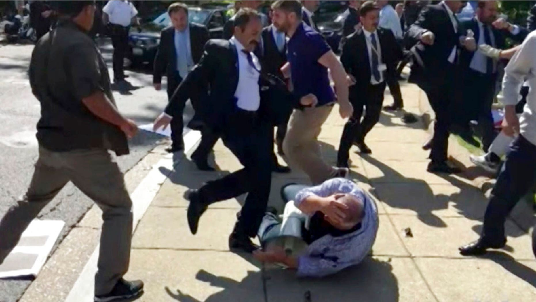 Members of Turkish President Recep Tayyip Erdogan's security detail are shown attacking peaceful protesters during Erdogan's trip to Washington in May.