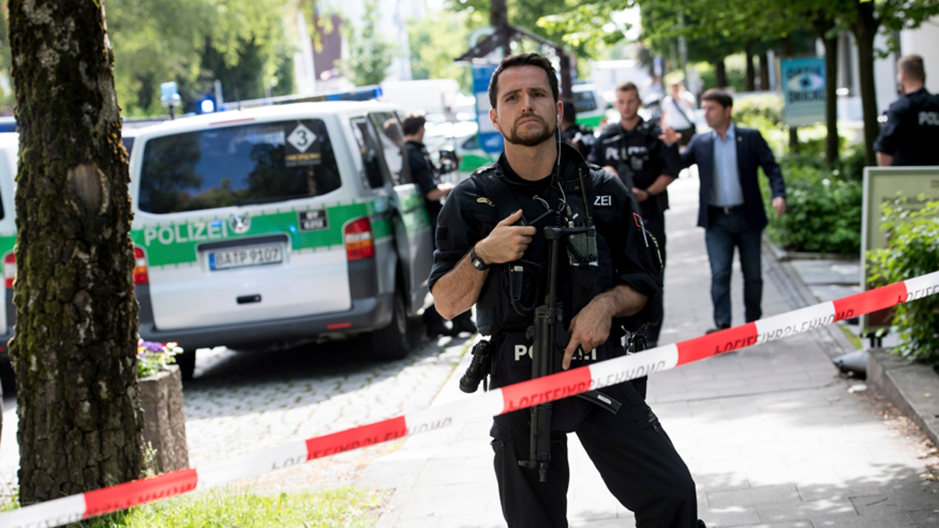 Police block a street near a subway station in Munich, Germany, Tuesday, June 13, 2017.  Several people were injured, including a police officer, in a shooting early Tuesday at a Munich subway station, police said. Munich police said in a tweet that the policewoman's injuries were serious. The suspect was also injured and is in custody. The shooting occurred during a morning police check at the Unterfoehring subway station, Munich police spokesman Michael Riehlein said. (Sven Hoppe/dpa via AP)