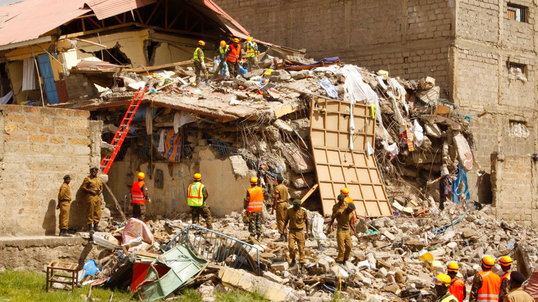 Rescuers work at the site of a building collapse in Nairobi, Kenya Tuesday, June 13, 2017. Nairobi Police Chief Japheth Koome said Tuesday that at least 10 people had been reported missing after the collapse Monday night. (AP Photo/Khalil Senosi)
