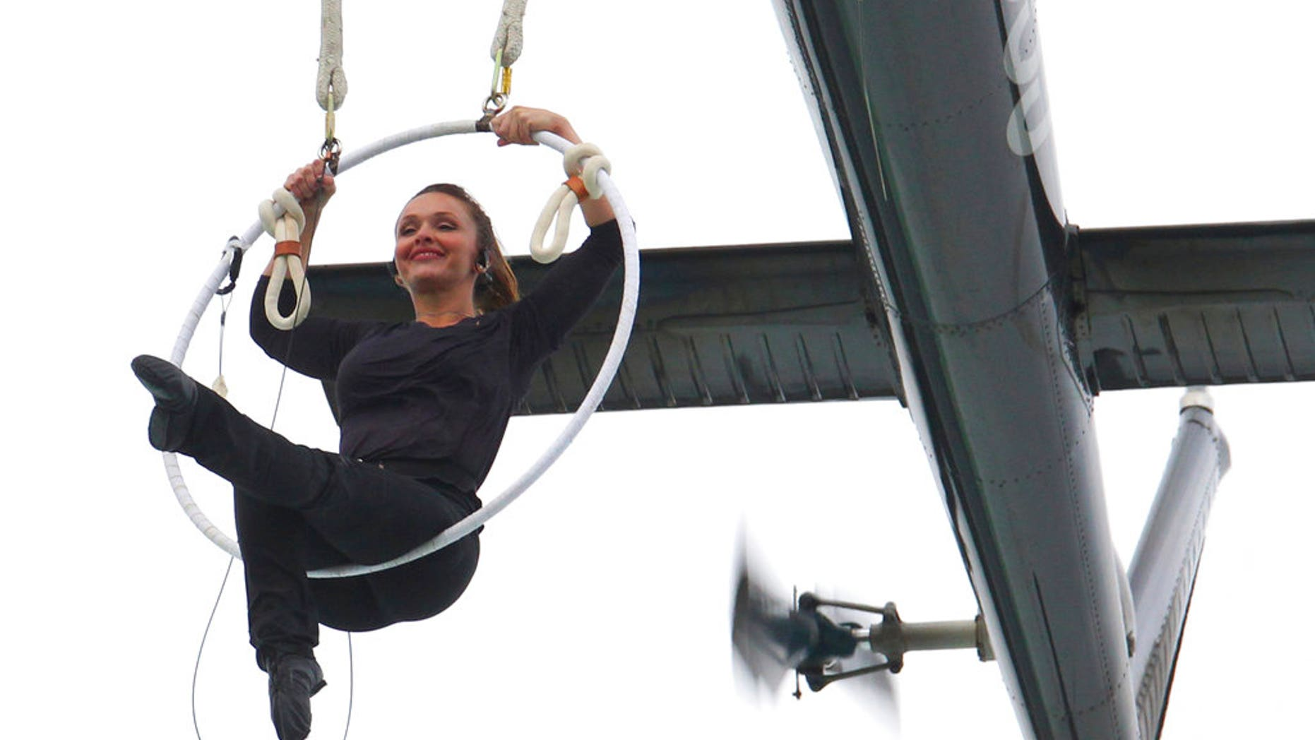 Erendira Wallenda performs a series of acrobatic maneuvers, including hanging by her teeth, while suspended from a helicopter above Niagara Falls in Niagara Falls, N.Y. Thursday June 15, 2017. (AP Photo/Bill Wippert)