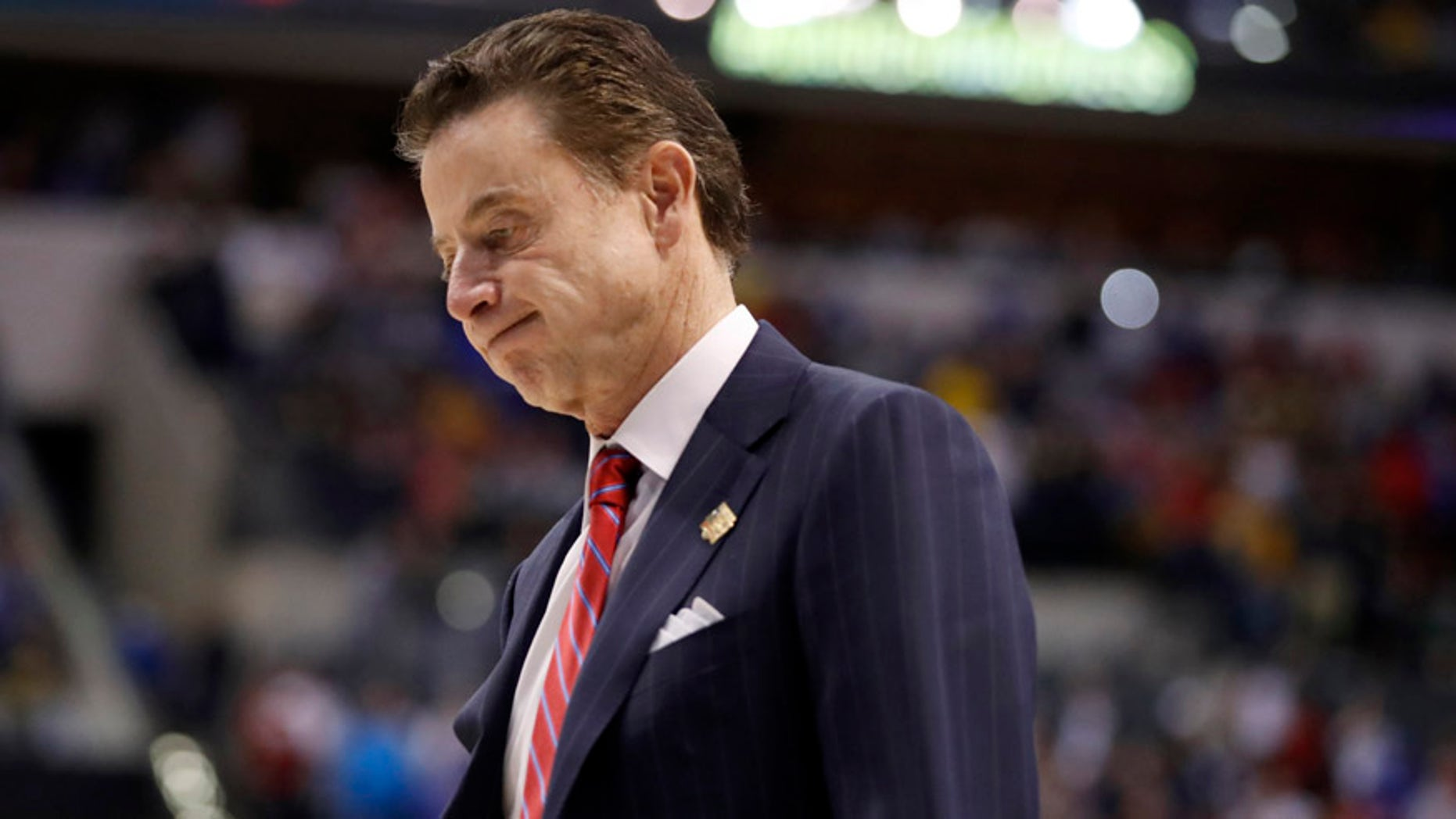 Louisville head coach Rick Pitino walks off the court in the men's NCAA college basketball tournament in Indianapolis on March 19, 2017.