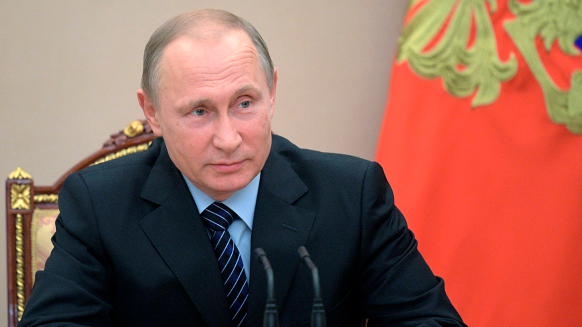 Russian President Vladimir Putin chairs a Security Council meeting in Moscow, Russia, Friday, June 16, 2017. The meeting was focused on the Russian military's claim that it had killed the Islamic State group's leader in an airstrike in Syria. (Alexei Druzhinin/Pool Photo via AP)