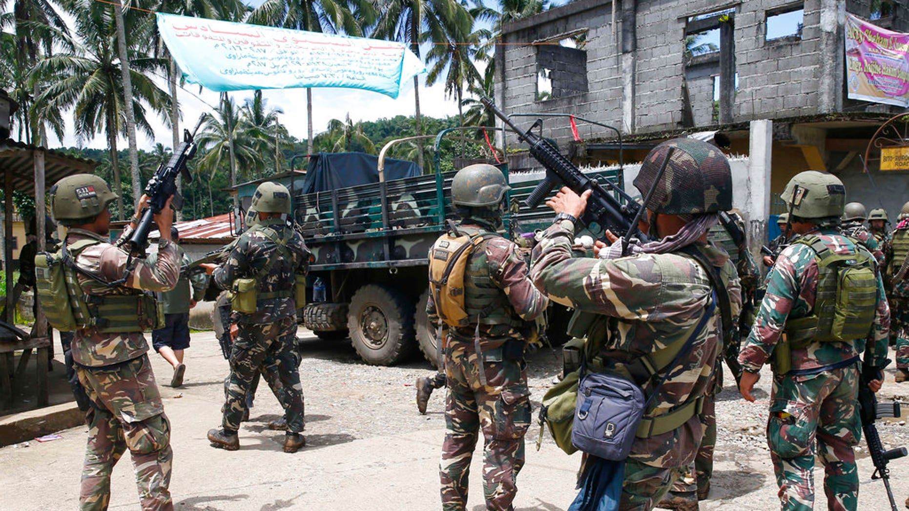 Philippines government troops prepare to head to the frontline as fighting with Muslim militants in Marawi city enters its second week in southern Philippines.