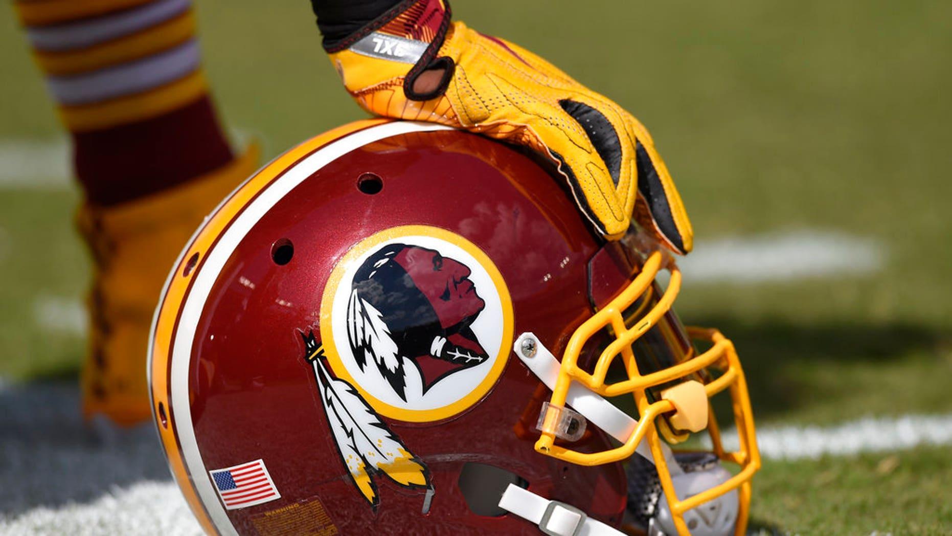 A Washington Redskins helmet on the sidelines.