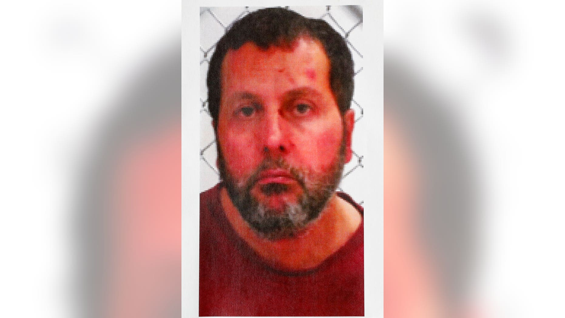 In this undated photo released by the FBI, Amor Ftouhi is shown. Ftouhi, a Canadian man, shouted in Arabic before stabbing a police officer in the neck at the Bishop International Airport in Flint, Mich., on Wednesday. The FBI says Ftouhi, 49, tried unsuccessfully to buy a gun while in the United States for five days. (AP Photo/Paul Sancya)