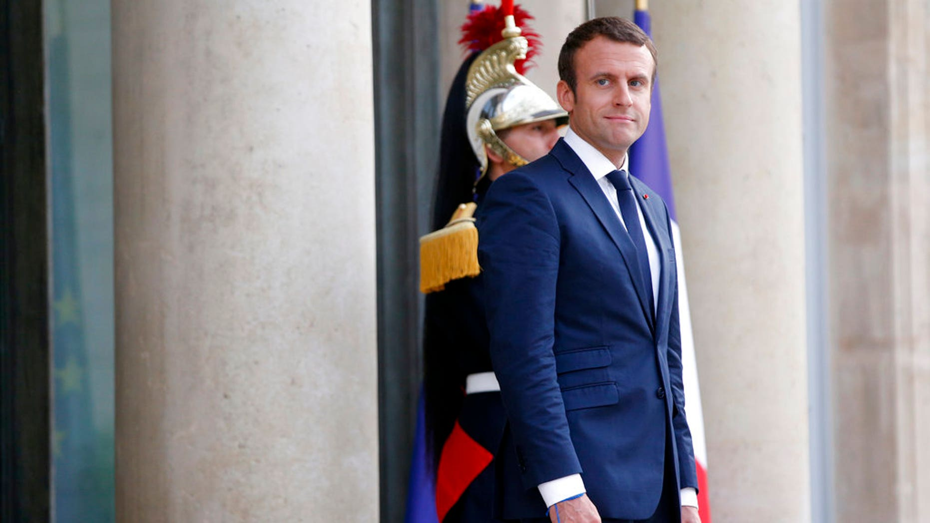 France's President Emmanuel Macron waits prior to welcoming Mexico's President Enrique Pena Nieto, for a dinner at the Elysee Palace, in Paris, Thursday, July 6, 2017. (AP Photo/Thibault Camus)