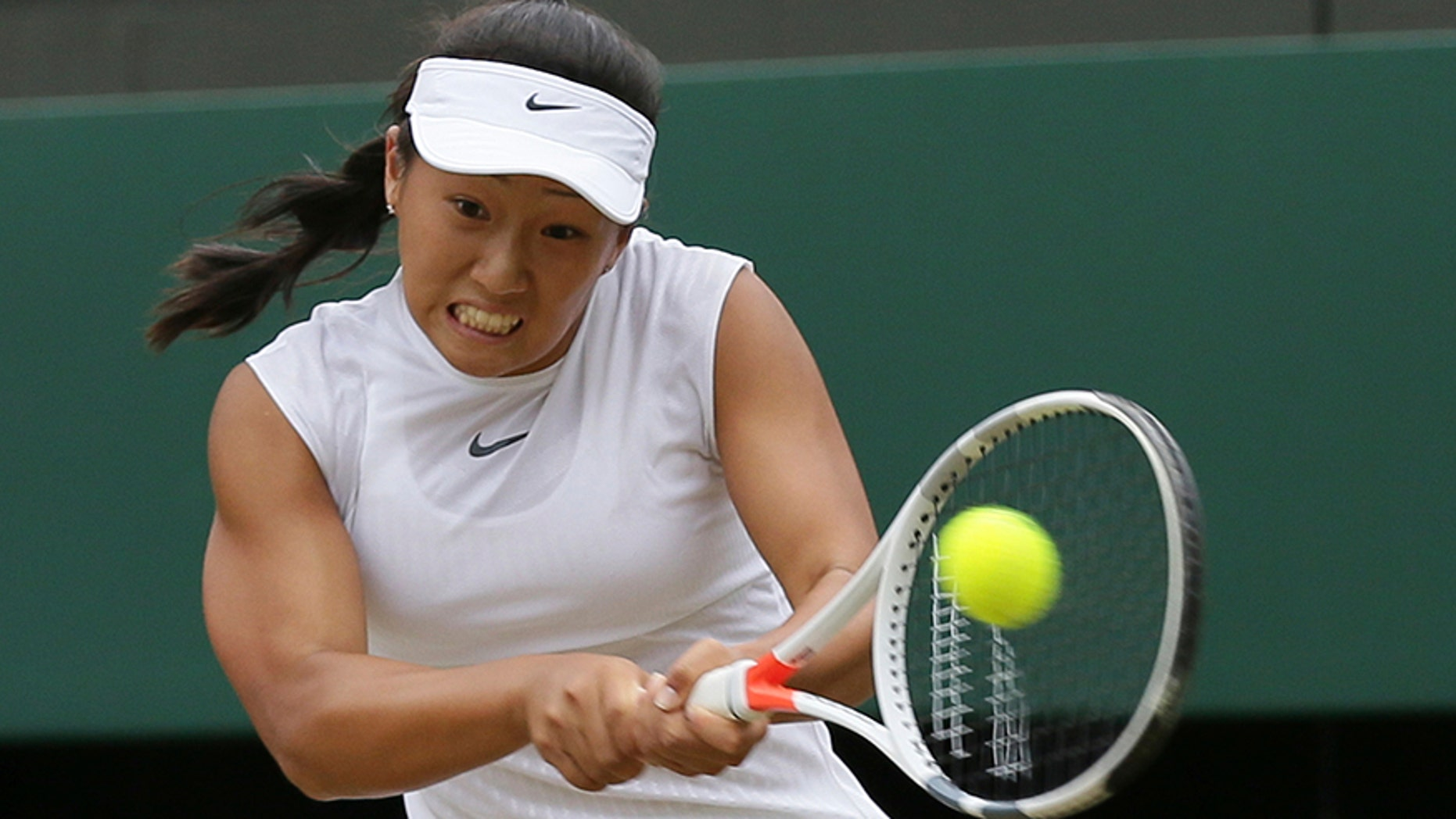 Claire Liu of the United States returns to compatriot Ann Li in the Girls' Singles final match on day twelve at the Wimbledon Tennis Championships in London Saturday, July 15, 2017. (AP Photo/Tim Ireland)