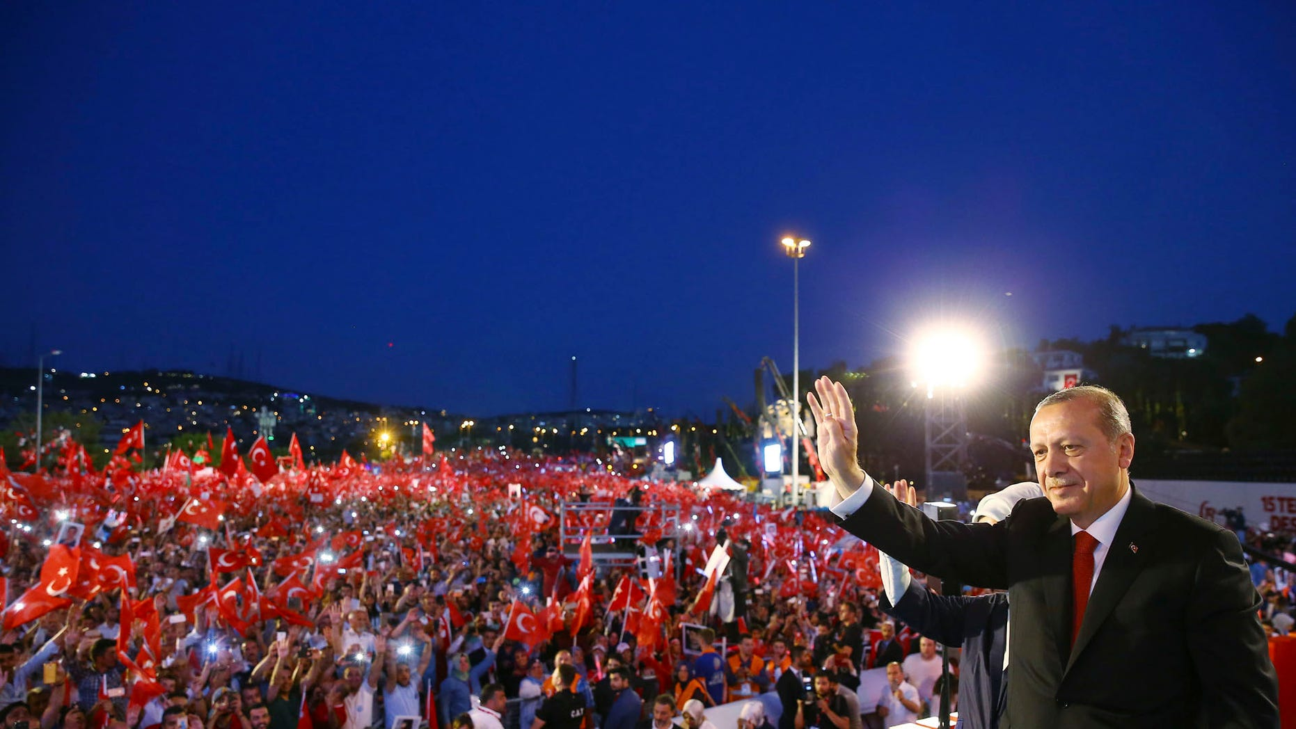 Turkey's President Recep Tayyip Erdogan waves to supporters in Istanbul.
