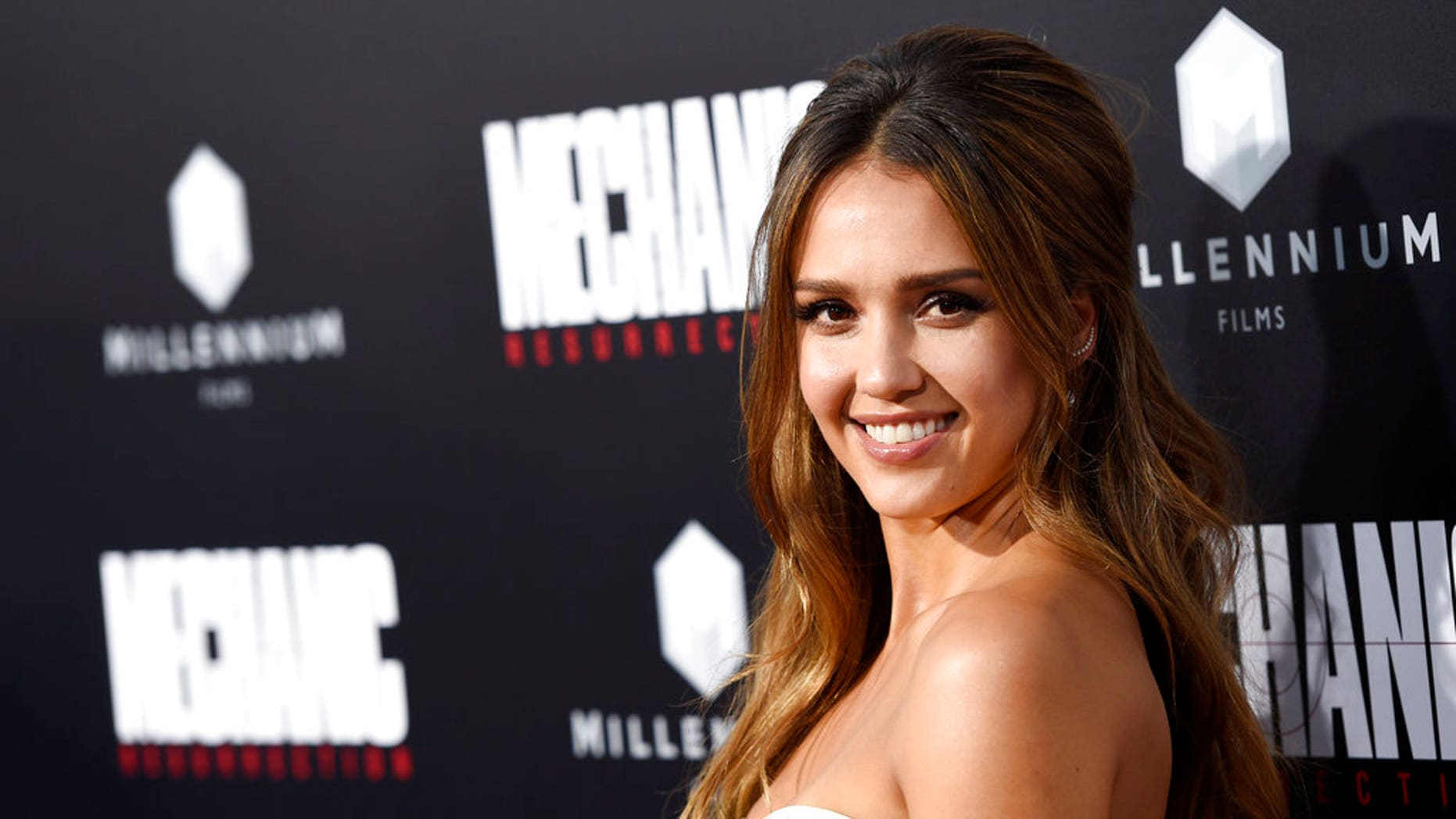 """Jessica Alba, a cast member in """"Mechanic: Resurrection,"""" poses at the premiere of the film at the Arclight Hollywood in Los Angeles. (Associated Press)"""