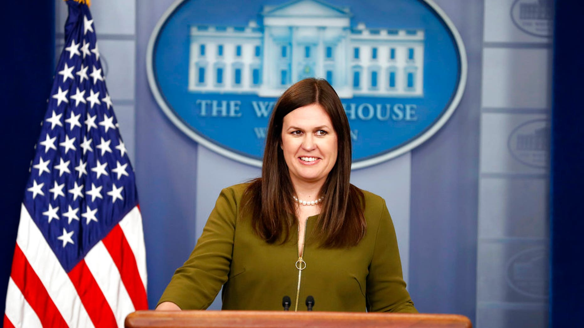 Deputy White House press secretary Sarah Huckabee Sanders smiles as she speaks during an off-camera press briefing at the White House in Washington, Tuesday, July 18, 2017. (AP Photo/Alex Brandon)