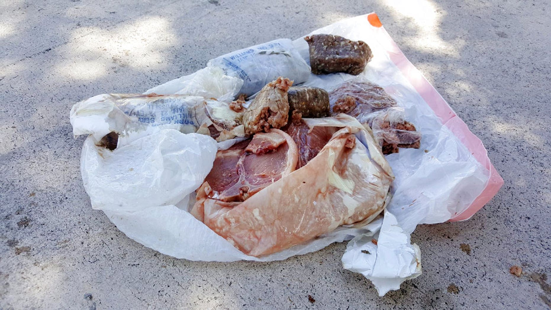A 15-pound bag of frozen pork landed on the roof of the Adair family home in Deerfield Beach, Fla., Saturday.