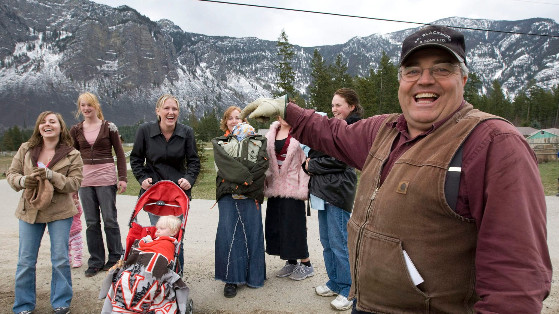In this April 21, 2008, file photo, Winston Blackmore with six of his daughters and some of his grandchildren.
