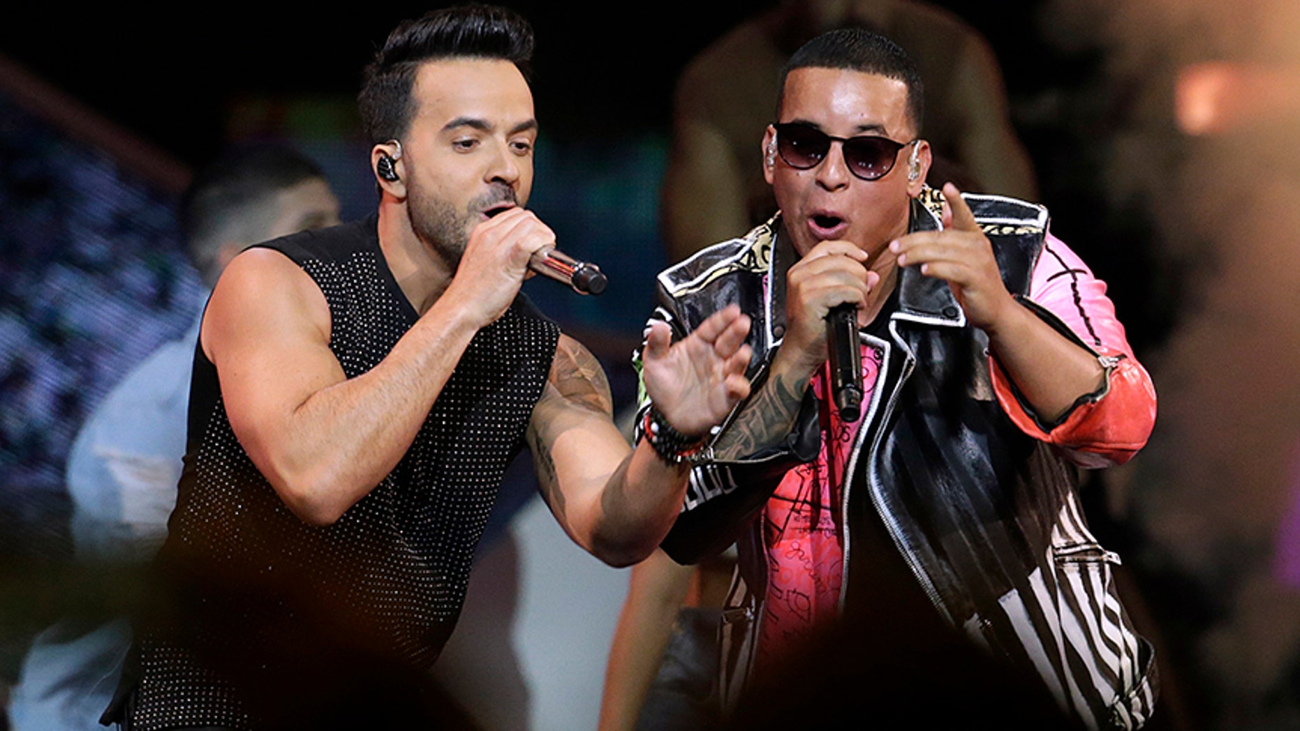 "FILE - In this April 27, 2017 file photo, singers Luis Fonsi, left and Daddy Yankee perform during the Latin Billboard Awards in Coral Gables, Fla. On Friday, Aug. 4, 2017, YouTube announced that the music video for the No. 1 hit song ""Despacito"" has become the most viewed clip on YouTube of all-time. (AP Photo/Lynne Sladky, File)"