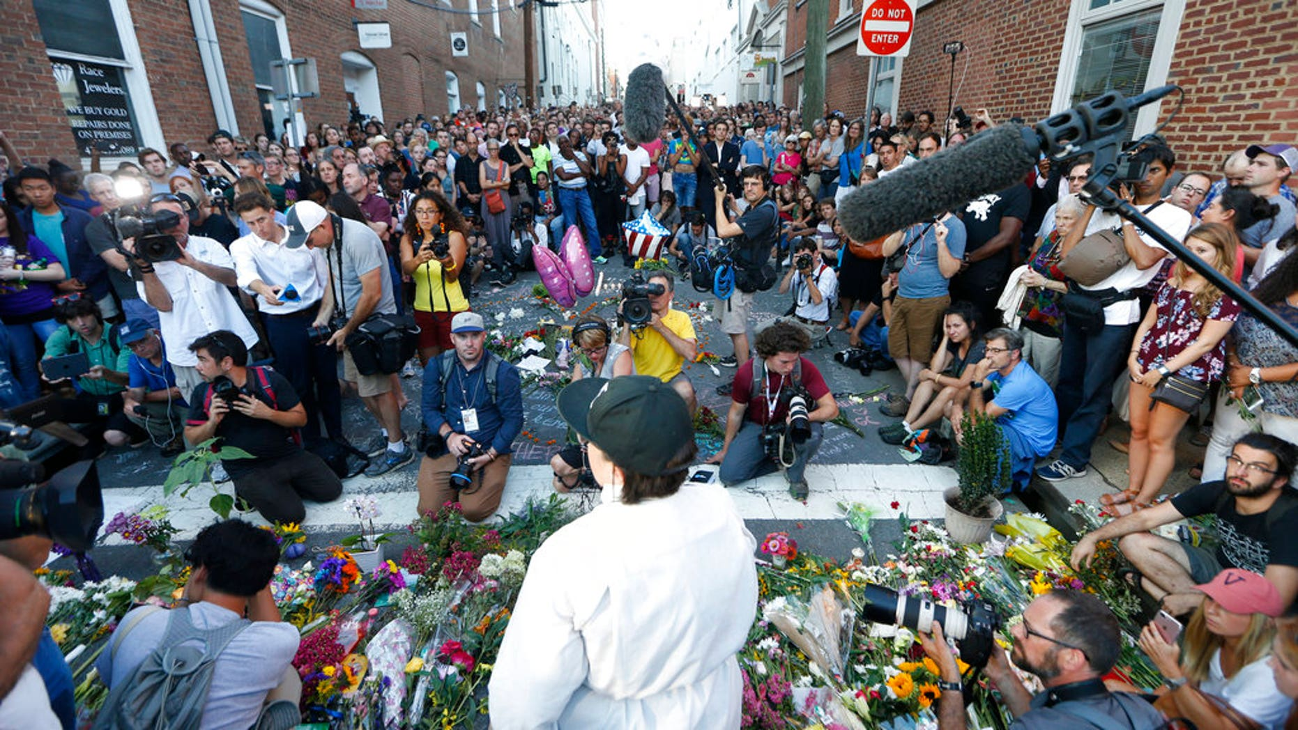A vigil was held in Charlottesville, Va., one day after a car rammed into a crowd of people, killing one and leaving 19 injured.