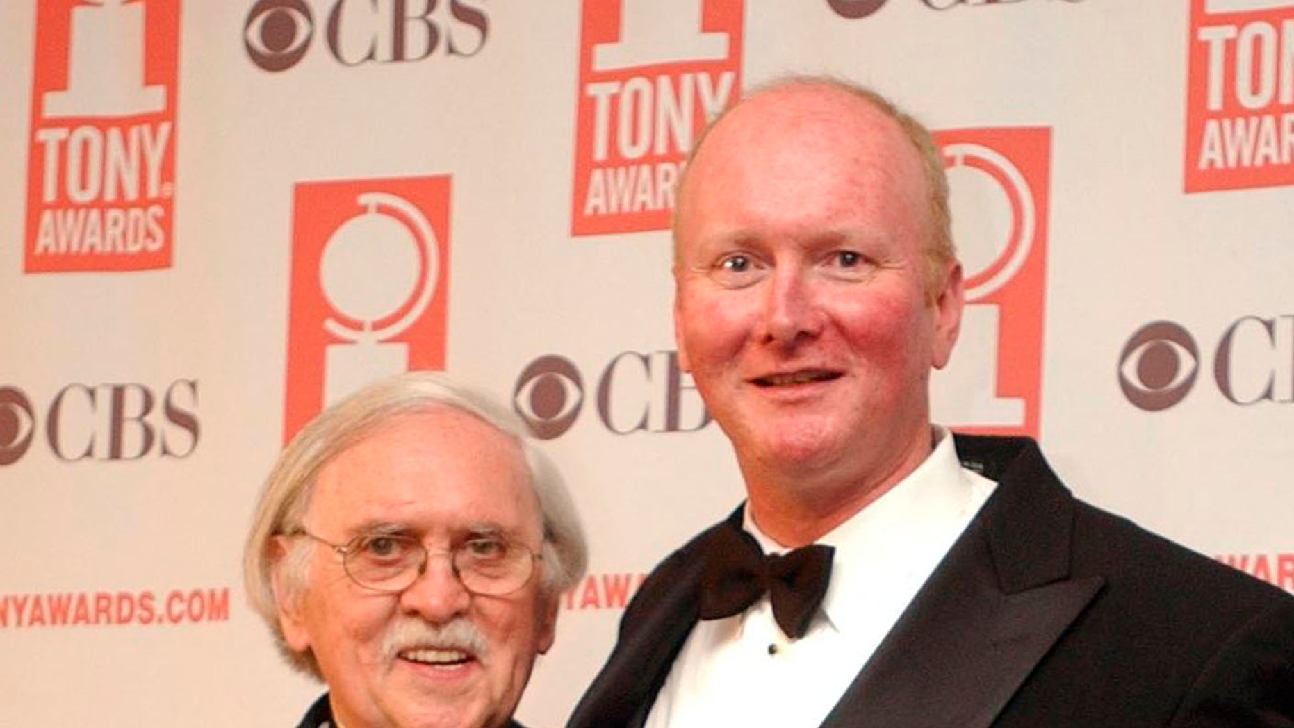 """FILE - In this June 8, 2003 file photo, Thomas Meehan, left, and Mark O'Donnell pose with their Tony awards for best book of a Musical for """"Hairspray"""" during the 57th Annual Tony Awards at New York's Radio City Music Hall. On Tuesday, Aug. 22, 2017, Martin Charnin said that Meehan, the three-time Tony Award-winning book writer, has died. Meehan was 88. (AP Photo/Mary Altaffer, File)"""