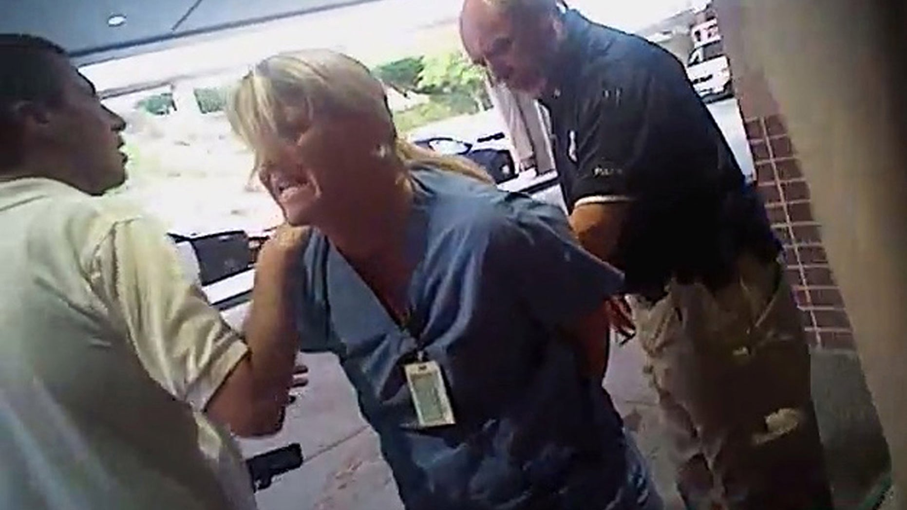 July 26, 2017: In this frame grab from video taken from a police body camera provided by attorney Karra Porter, nurse Alex Wubbels is arrested by a Salt Lake City police officer at University Hospital in Salt Lake City.