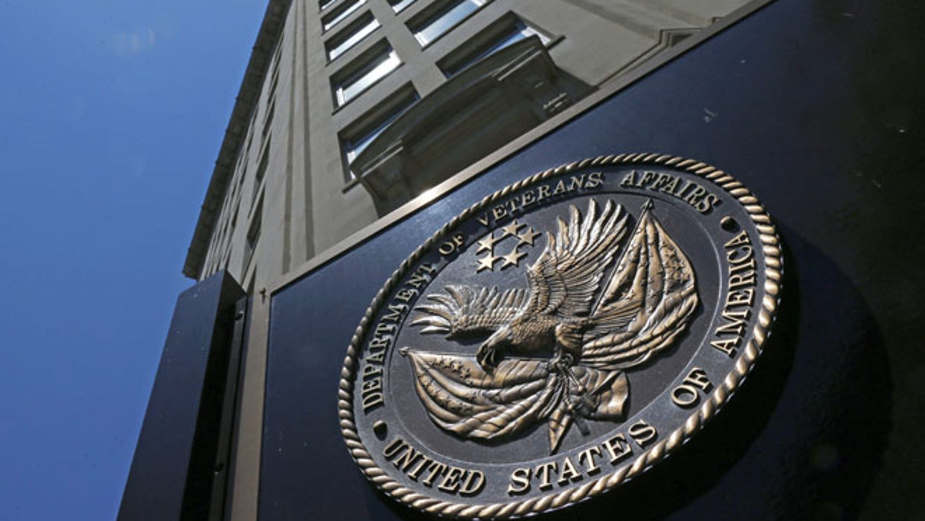 In this June 21, 2013, file photo, the seal affixed to the front of the Department of Veterans Affairs building in Washington.