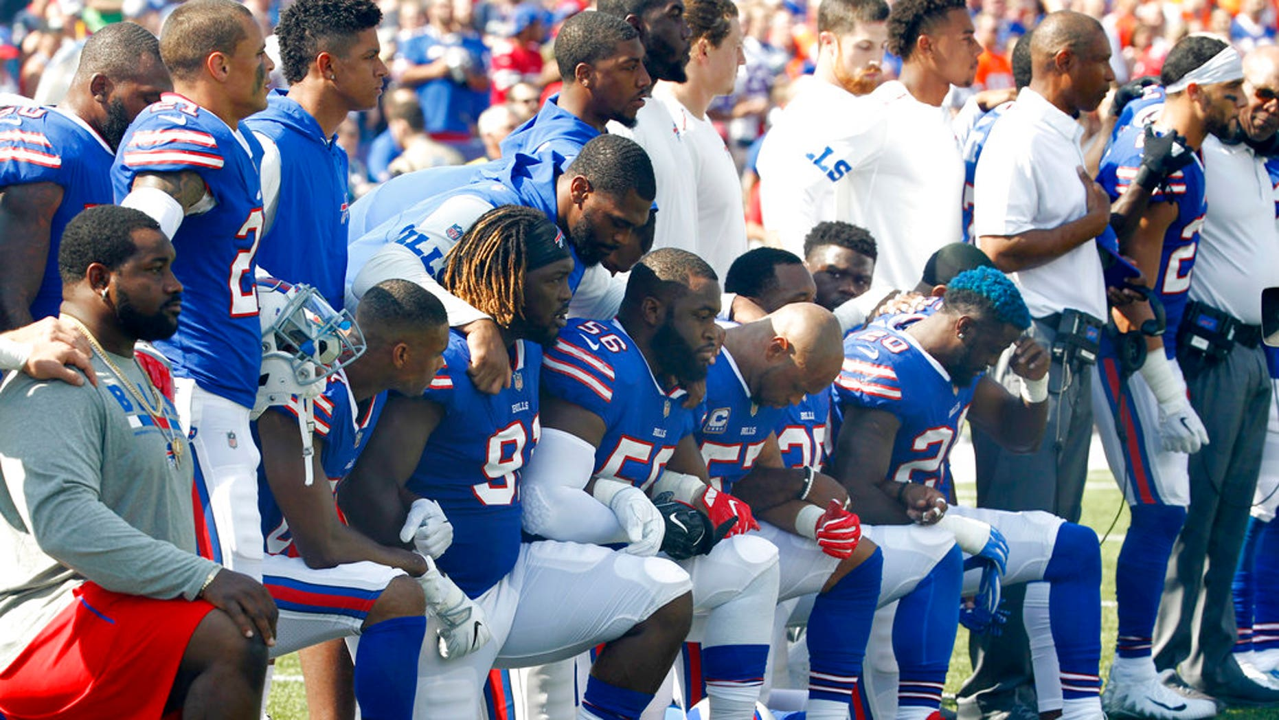 Buffalo Bills players take a knee during the national anthem Sept. 24 ahead of their game against the Denver Broncos.